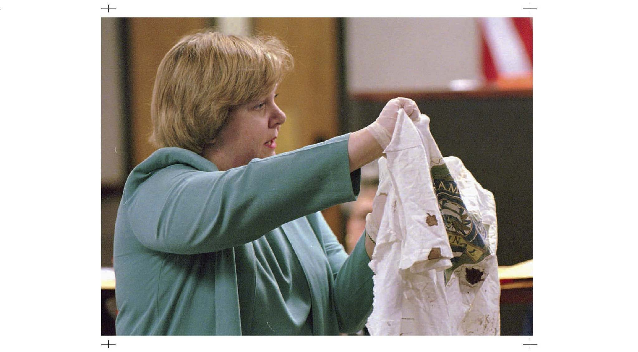 Suzanne Livingston, a DNA expert at the Florida Department of Law Enforcement Crime Lab, displays a blood-spotted T-shirt during Ralph Crompton's murder trial. (Vern Miller / Panama City News Herald files)