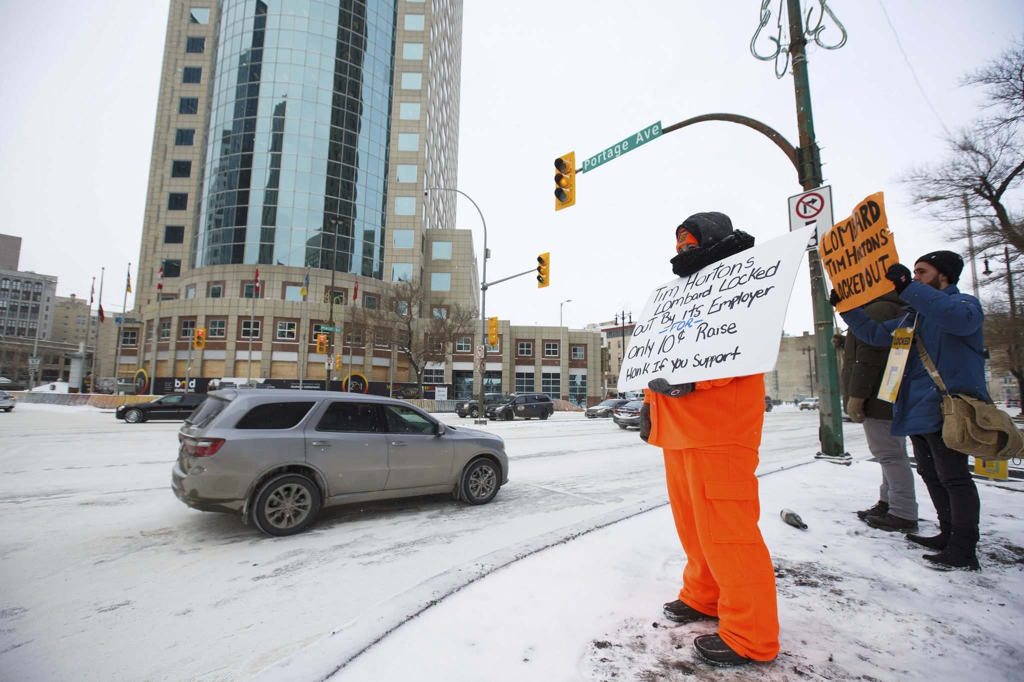 MIKE DEAL / WINNIPEG FREE PRESS</p><p>Locked out Tim Horton's employees and supporters demonstrate at Portage and Main Thursday, just outside of 1 Lombard Place where the coffee shop is located in the underground shopping centre.</p>