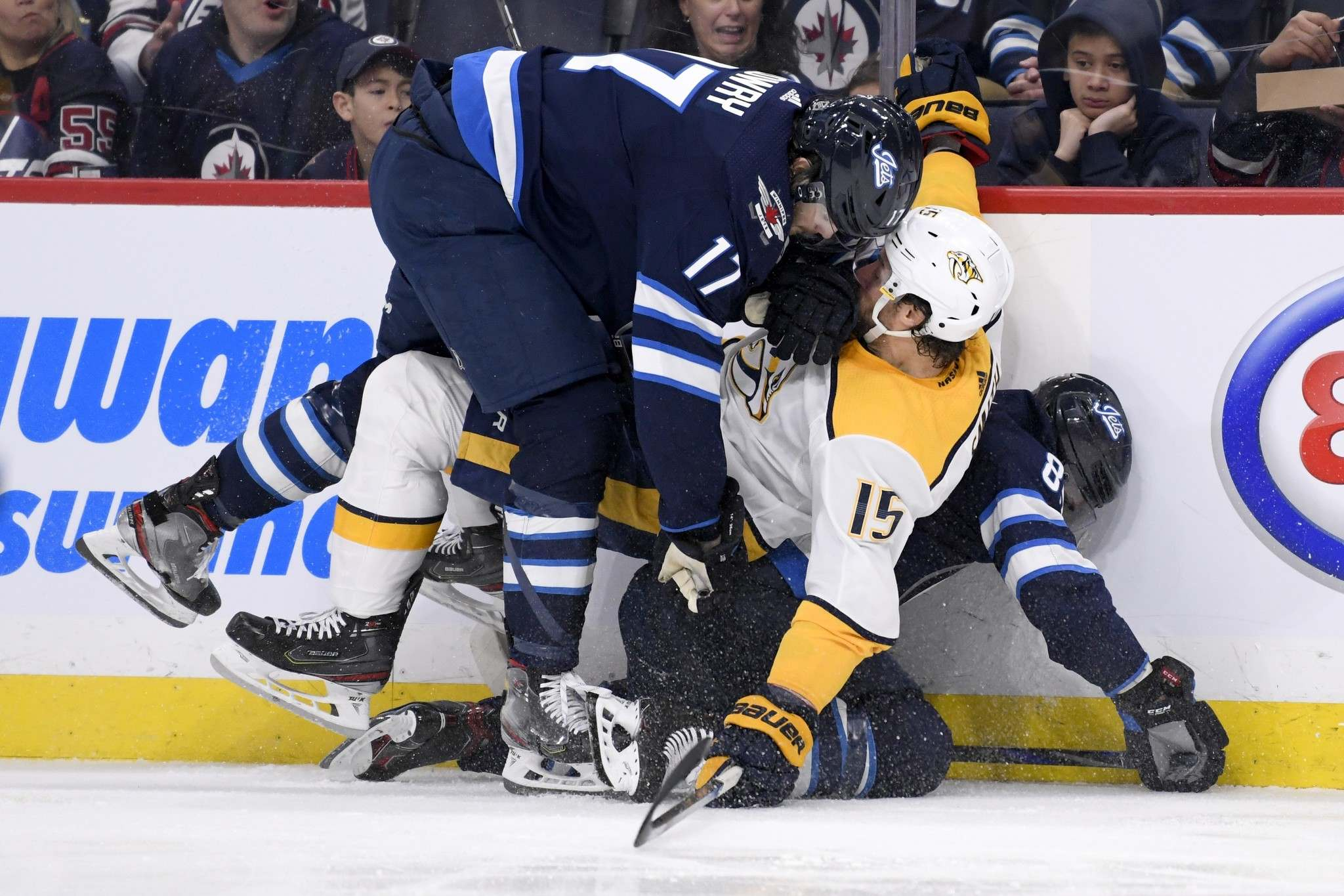 Winnipeg Jet Adam Lowry (17) and Mathieu Perreault (85) collide with Nashville Predators' Craig Smith (15) during second period NHL action in Winnipeg on Sunday. (Fred Greenslade / The Canadian Press)</p>
