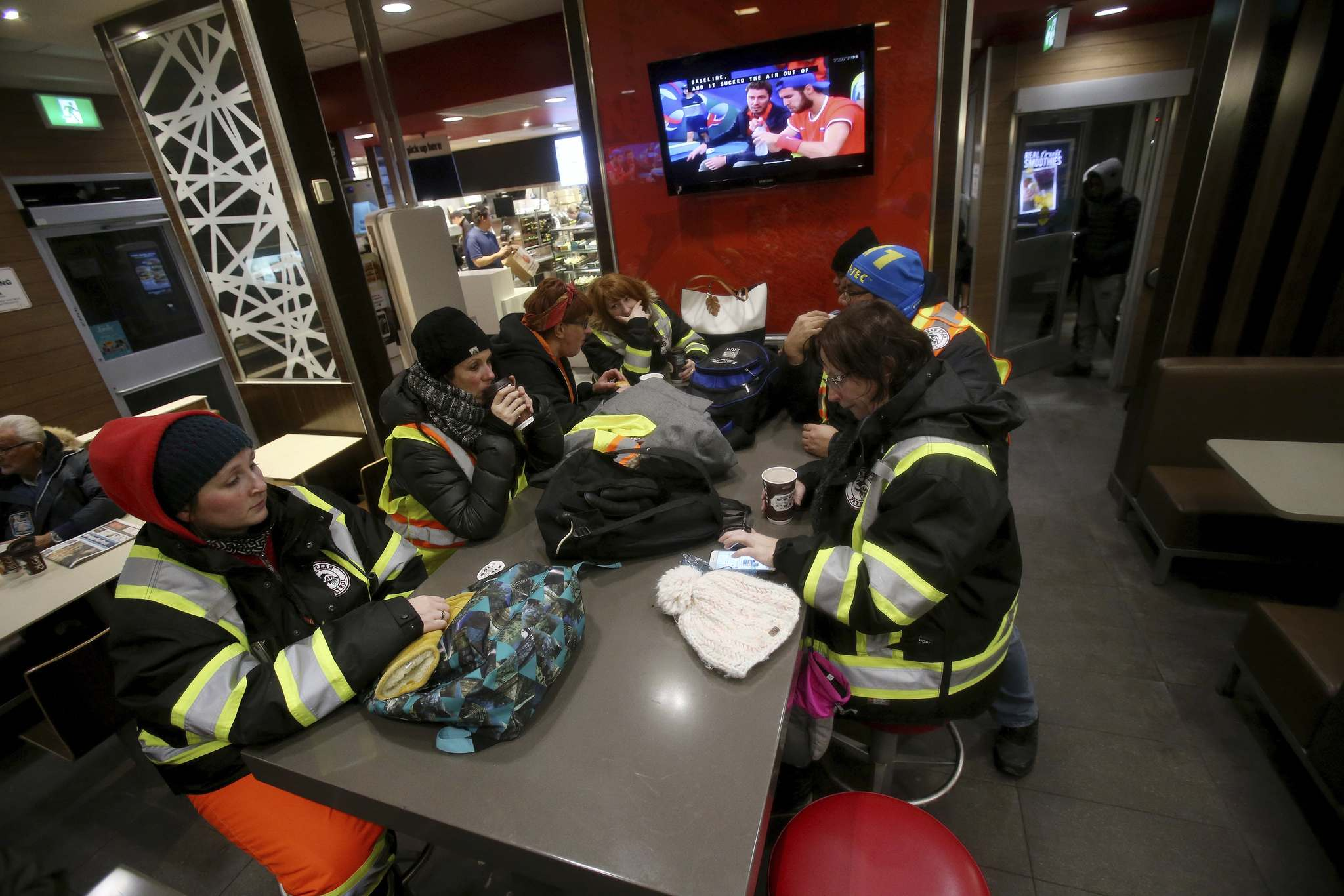 SHANNON VANRAES / WINNIPEG FREE PRESS</p><p>With temperatures reaching into the -30s, volunteers with the West Broadway Bear Clan Partol head into a McDonald's restaurant to warm up at the halfway point of a three-hour-long patrol.</p>