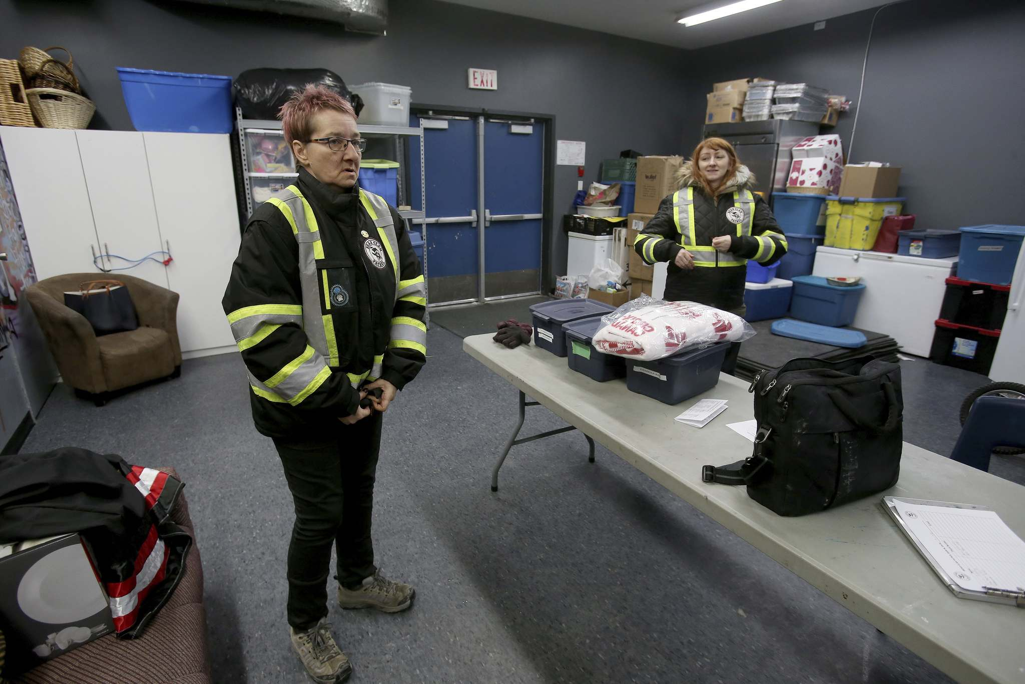 "SHANNON VANRAES / WINNIPEG FREE PRESS</p><p>Angela Janeczko, co-founder of the West Broadway Bear Clan Patrol, zips up get parka inside the organization's ""den"" at the Broadway Neighbourhood Centre on January 10, 2020.</p>"