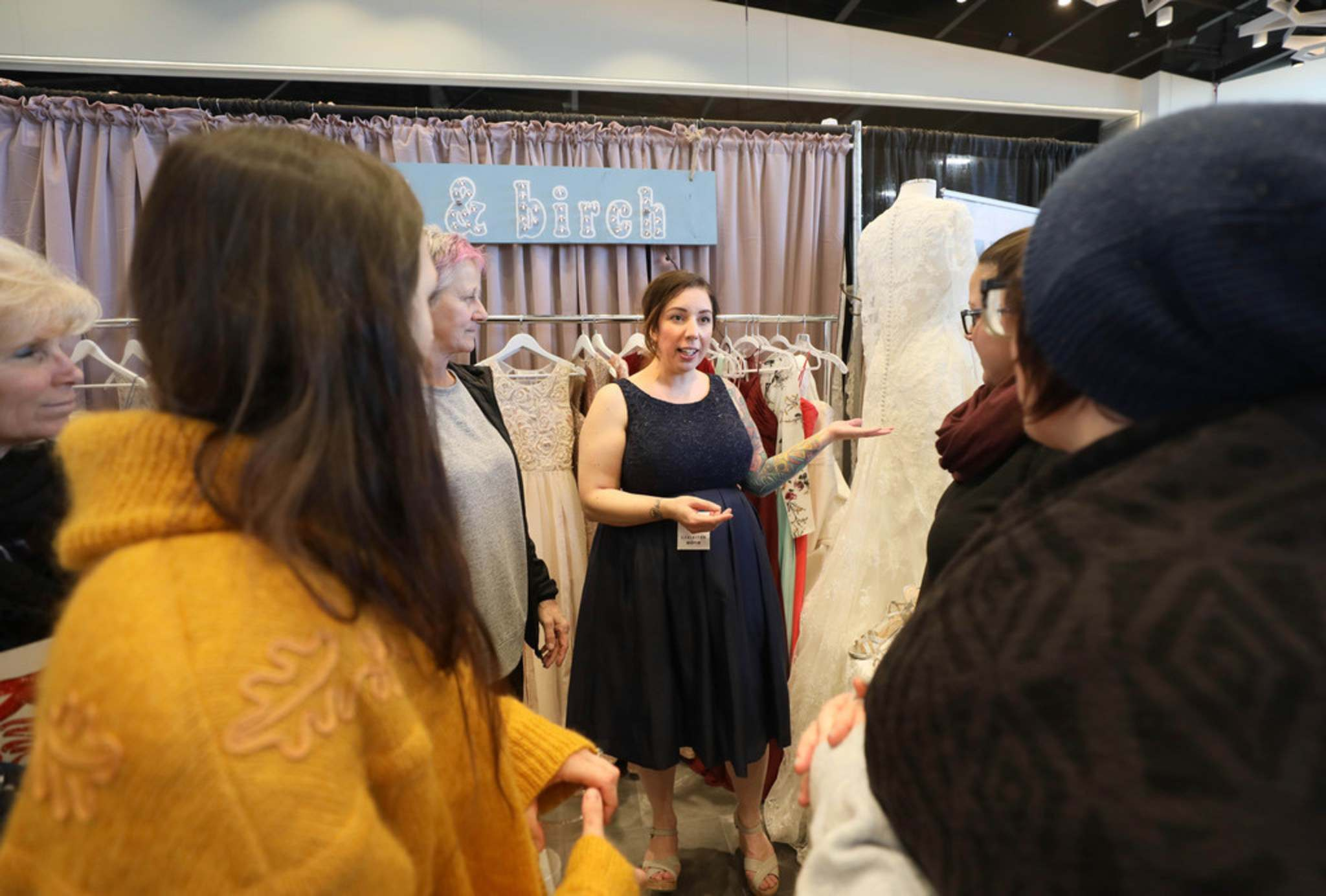 Ruth Bonneville / Winnipeg Free Press</p><p>Amanda Murdock owner of Pearl & Birch wedding consignment store, shows potential clients her dresses at her booth at the the Wonderful Wedding Show at RBC Convention Centre.</p>