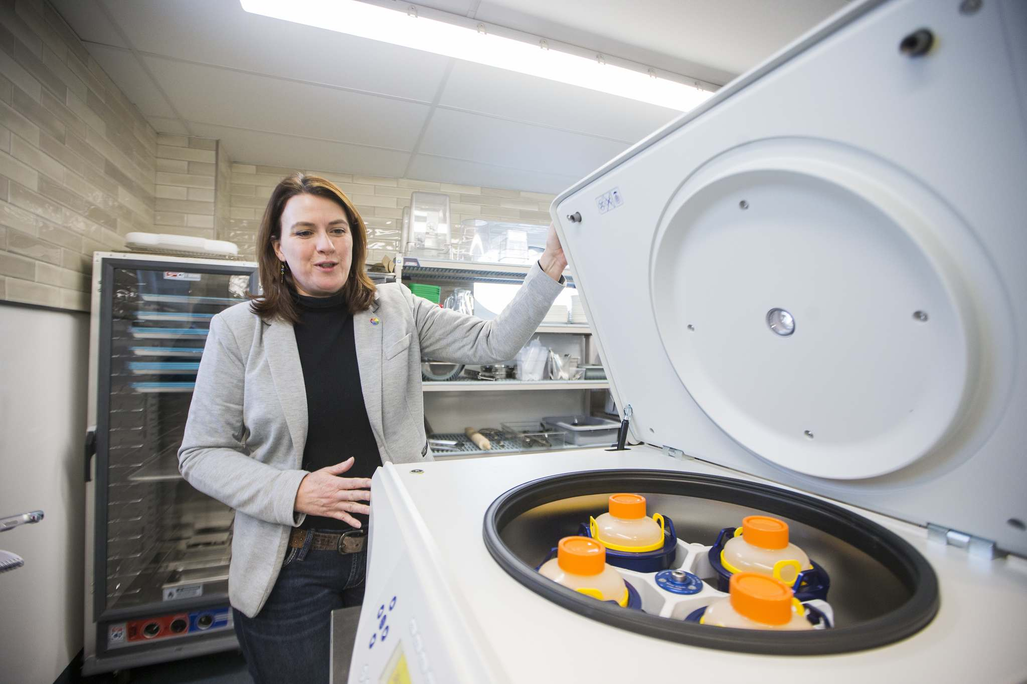Mavis McRae, head of operations, opens up a centrifuge at the RRC's Culinary Research and Innovation Centre. McRae said they are exploring the licensing and regulatory requirements required to work with cannabis companies. (Mikaela MacKenzie / Winnipeg Free Press)
