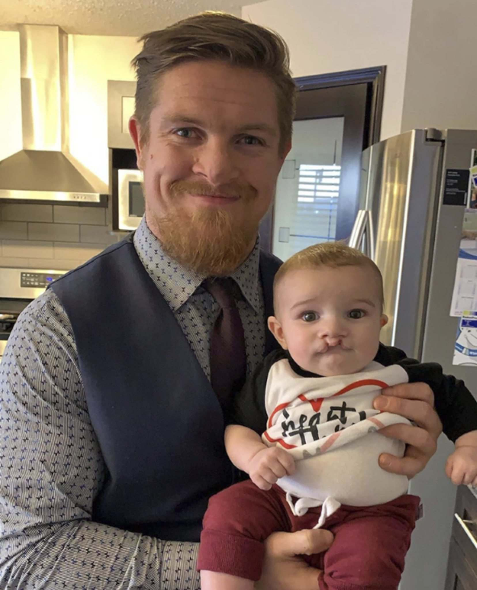 CREDIT: Twitter</p><p>Adam Bighill and son Beau</p>