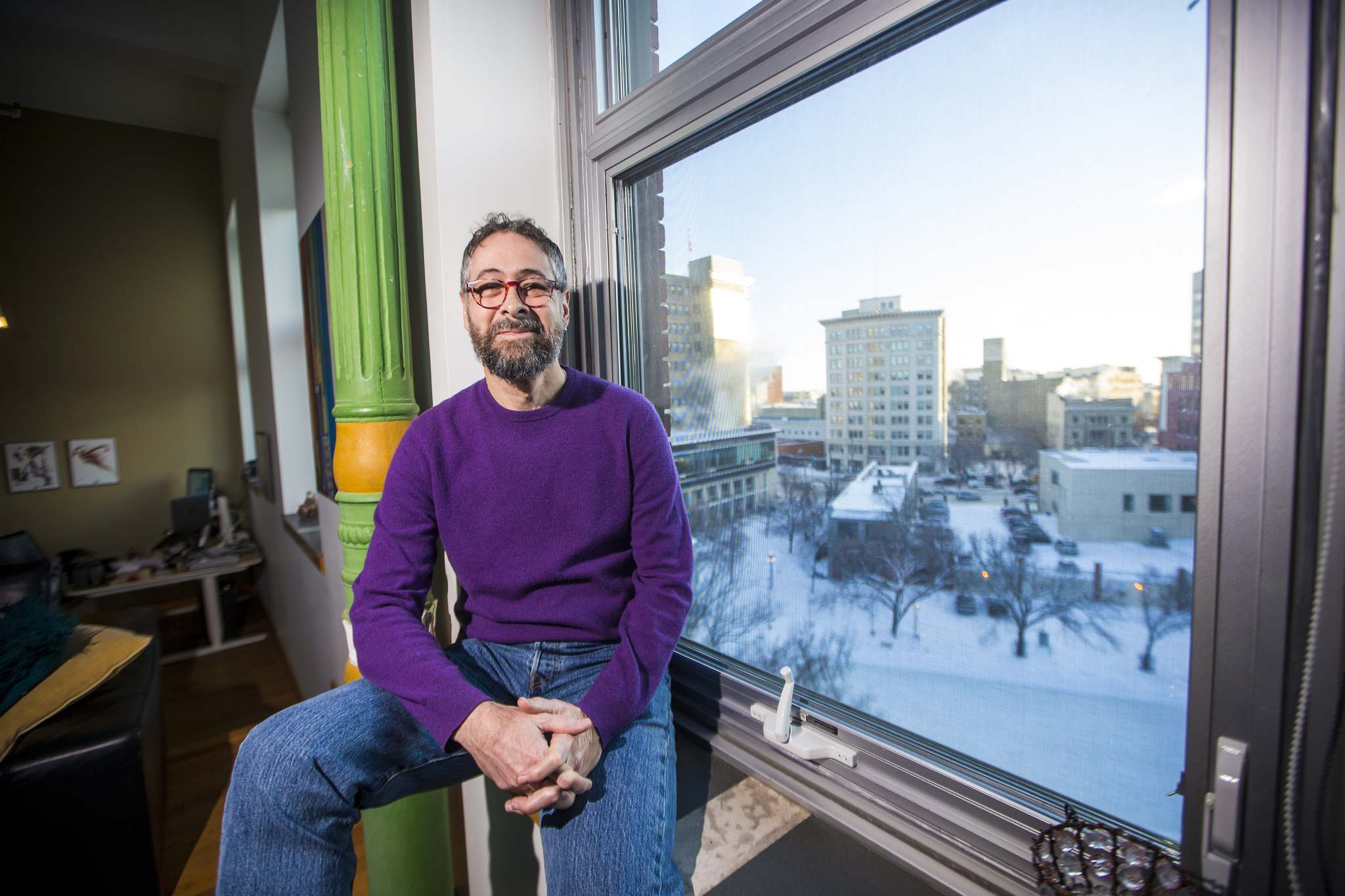 Steve Porter, who moved to the Exchange District 17 years ago, has witnessed a massive growth in population during that time. (Mikaela MacKenzie / Winnipeg Free Press)
