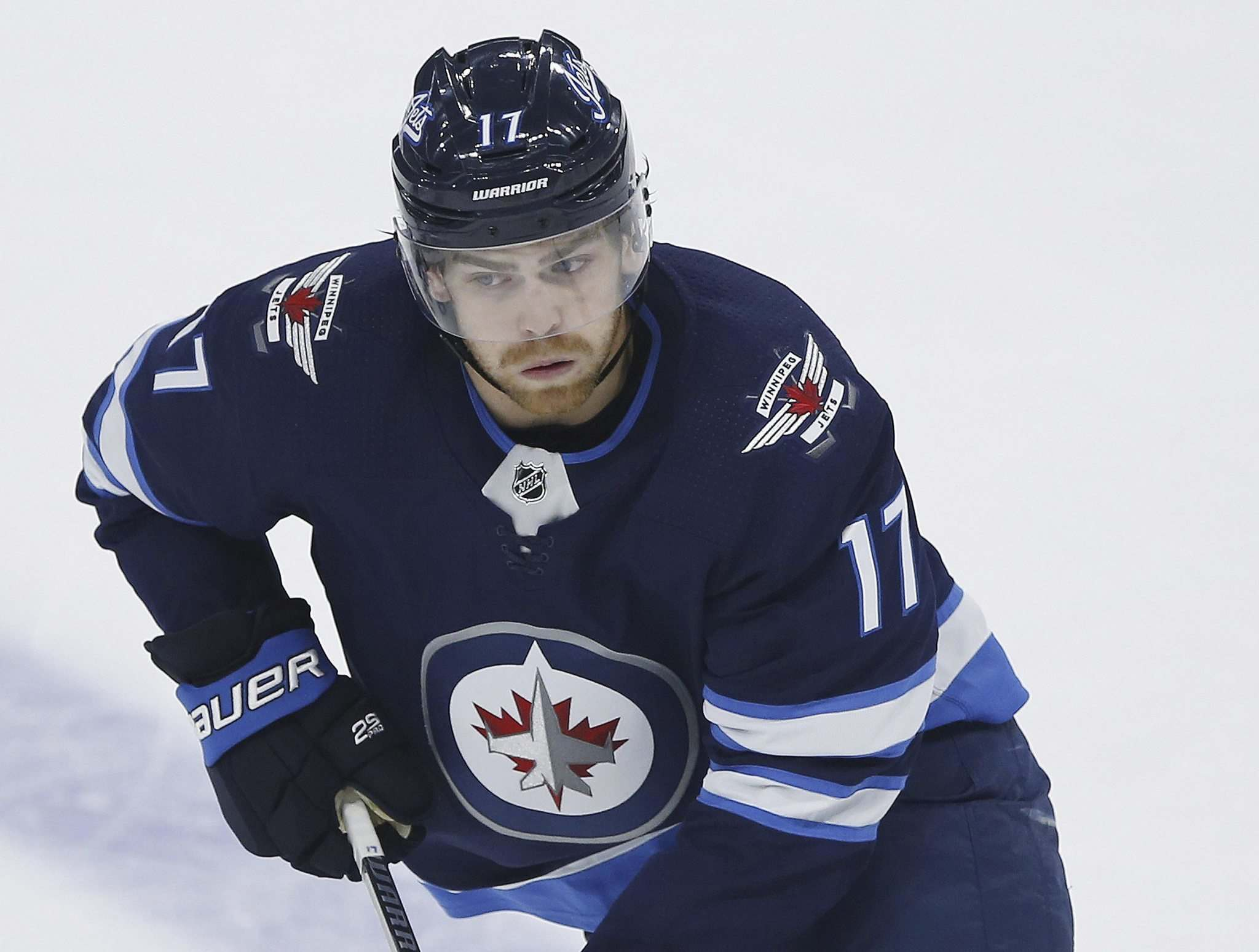 John Woods / The Canadian Press files</p><p>Injured Winnipeg Jets centre Adam Lowry will be assessed today after being knocked out of Sunday's game in Chicago.</p></p>