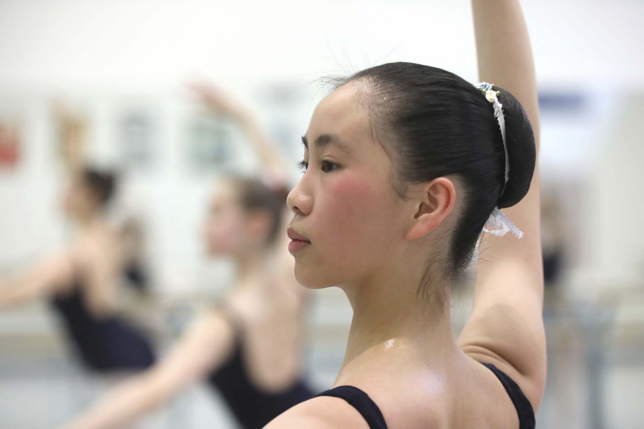 Elisha wakes up early, giving her time to roll out her muscles, stretch out her feet with a resistance band and, of course, pin her hair up into a ballet bun before making her way to the studio.