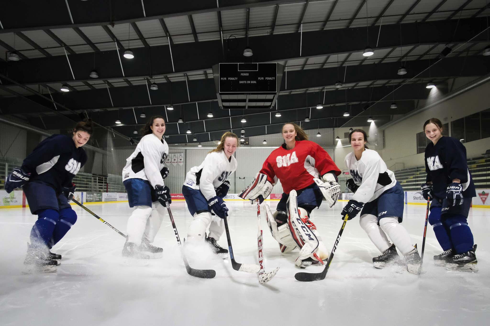 Aimee Patrick (from left), Kate Bumstead, Gabi Dawyduk, Meagan Relf, Lainie Nichols and Chloe Oleksiak are all graduating with scholarships to play hockey at the university level next season. (Daniel Crump / Winnipeg Free Press)