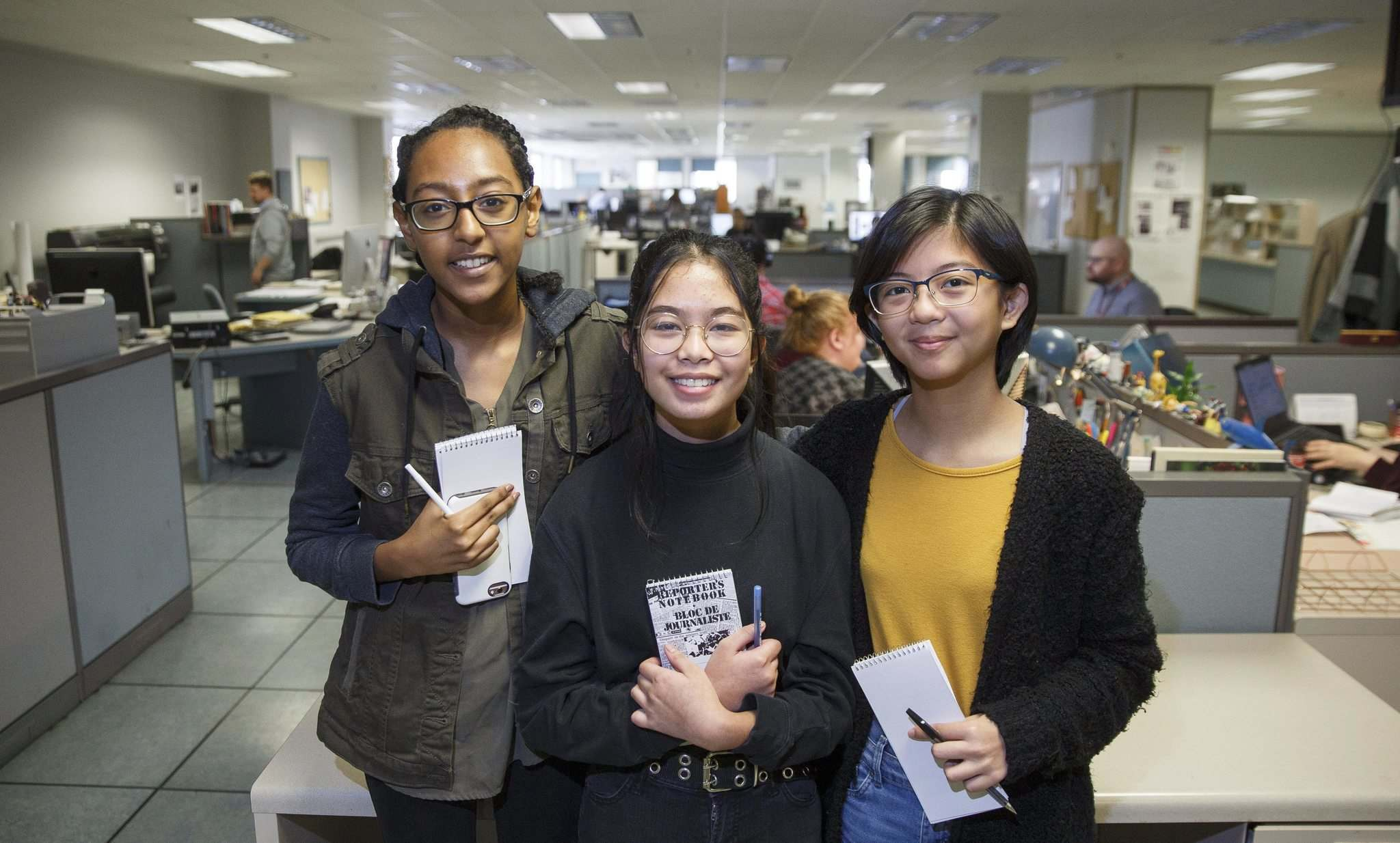 Kalkidan Mulugeta (from left), Alex Payawal, and Rory Ramos are ready to write. (Mike Deal / Winnipeg Free Press)