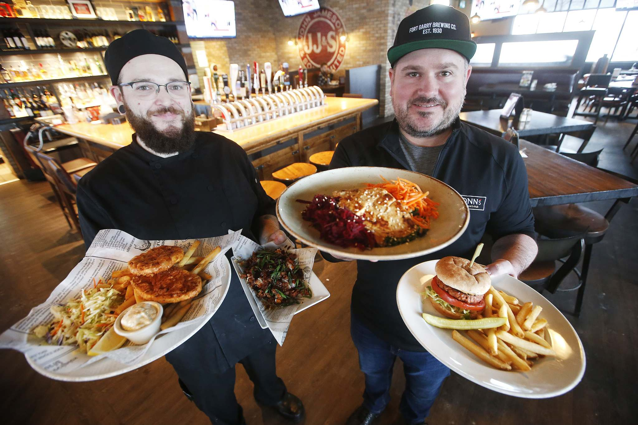 JOHN WOODS / WINNIPEG FREE PRESS</p><p>Fionn MacCool's kitchen manager Dennis Burnett (left) and owner Jay Kilgour show off some of the many plant based, meat-like products on the menu at the restaurant.</p>