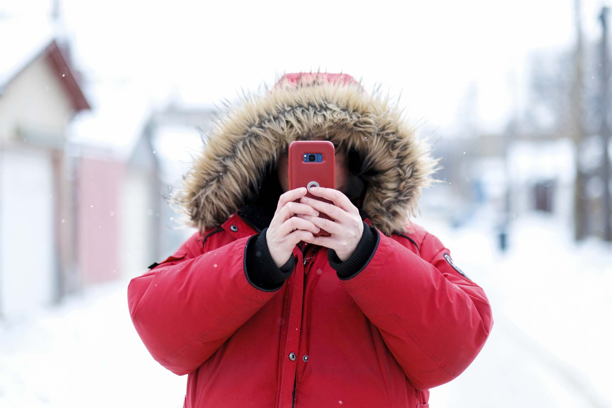 Mike Sudoma / Winnipeg Free Press</p><p>Founder and photographer of the growing Instagram account @shoppingcartsofwinnipeg, takes a photo on her phone in a West End back lane while out on the hunt for shopping carts to photograph.</p>
