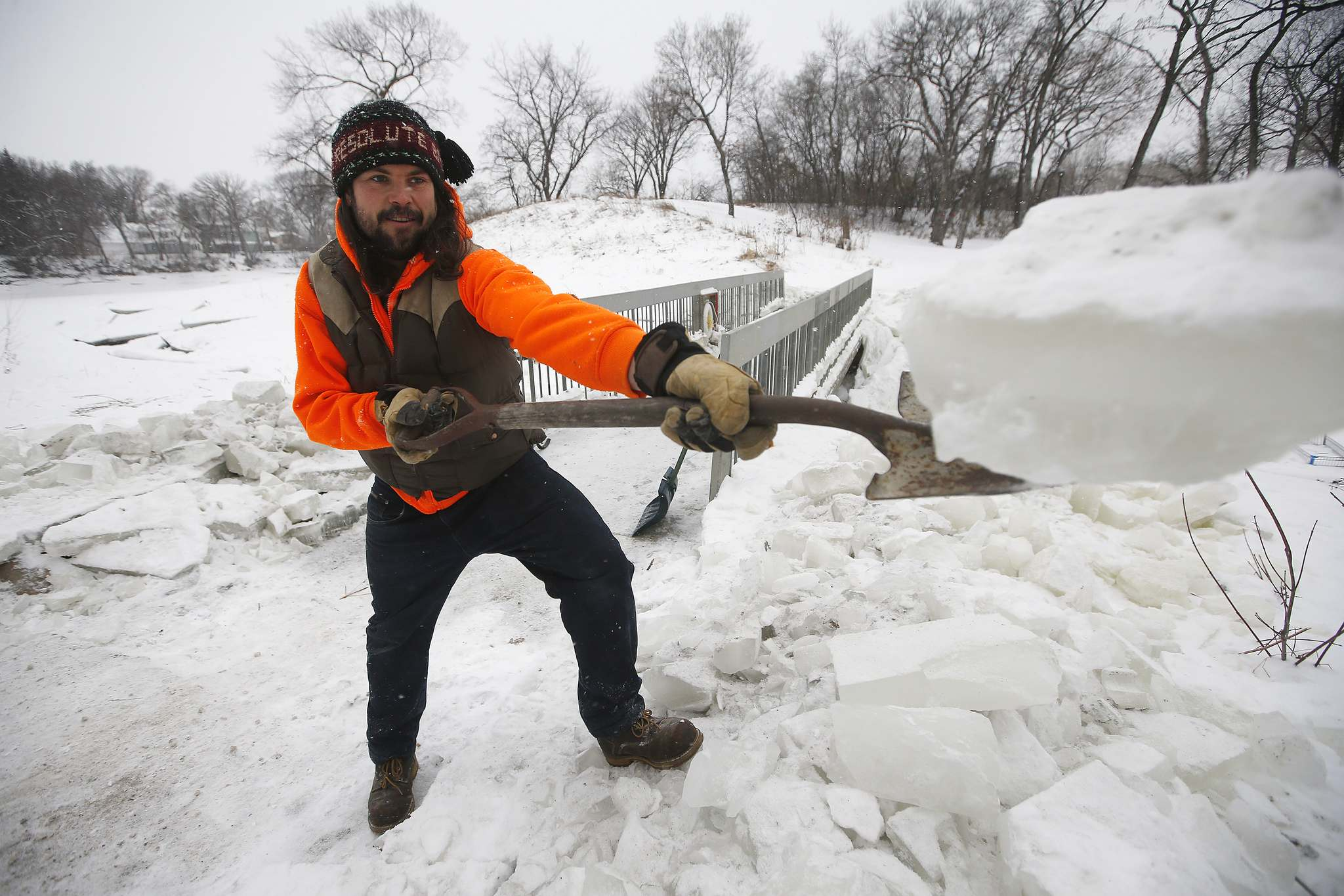 JOHN WOODS / WINNIPEG FREE PRESS FILES</p><p>Brad Hignell, pictured, and Wolseley resident Chris Beauvilain shovelled the snow and ice from the Omand's Creek bridge after the city closed it to pedestrians in December.</p>