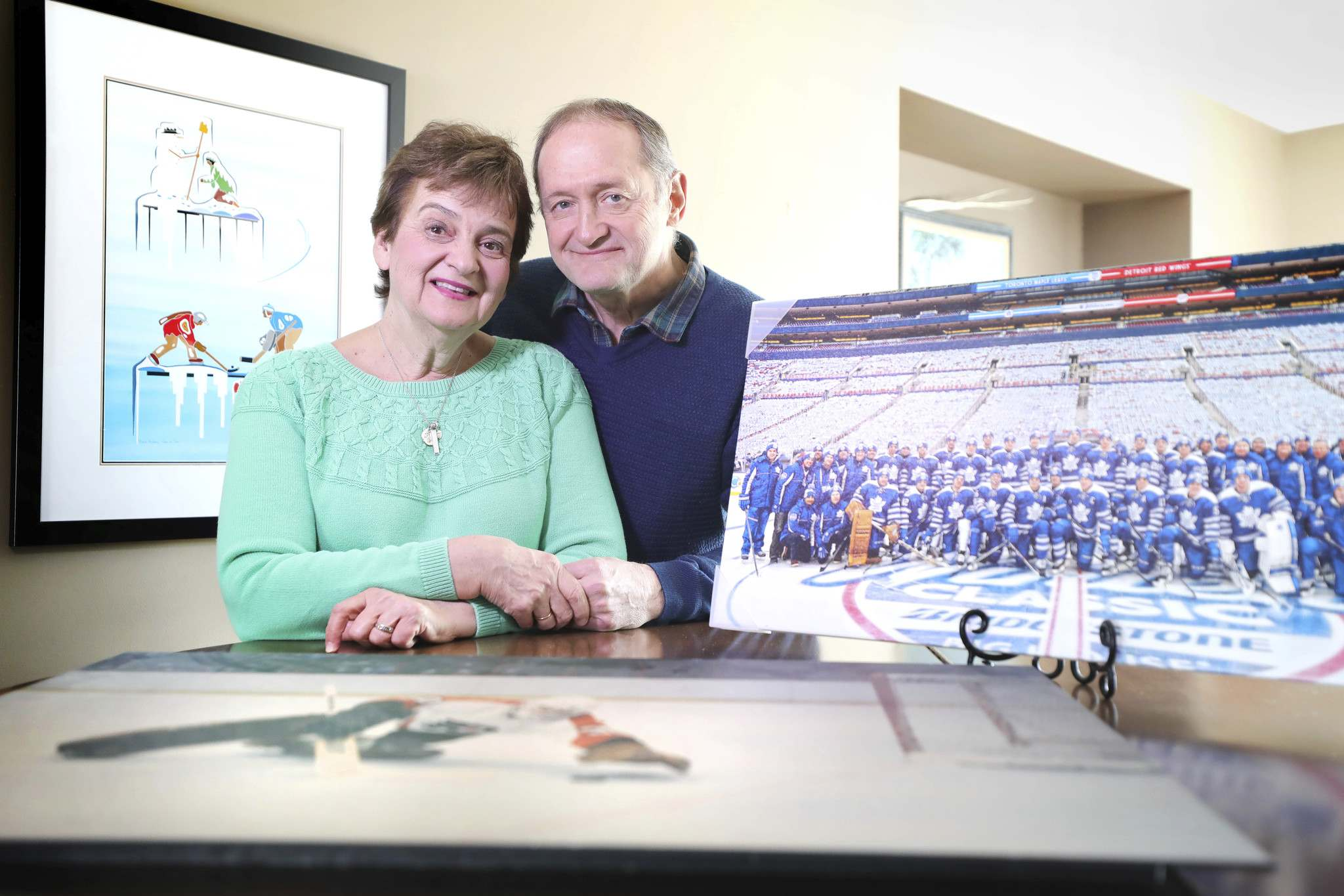 St. Croix with his wife Michelle and some of the memorabilia from his NHL career. (Ruth Bonneville / Winnipeg Free Press)