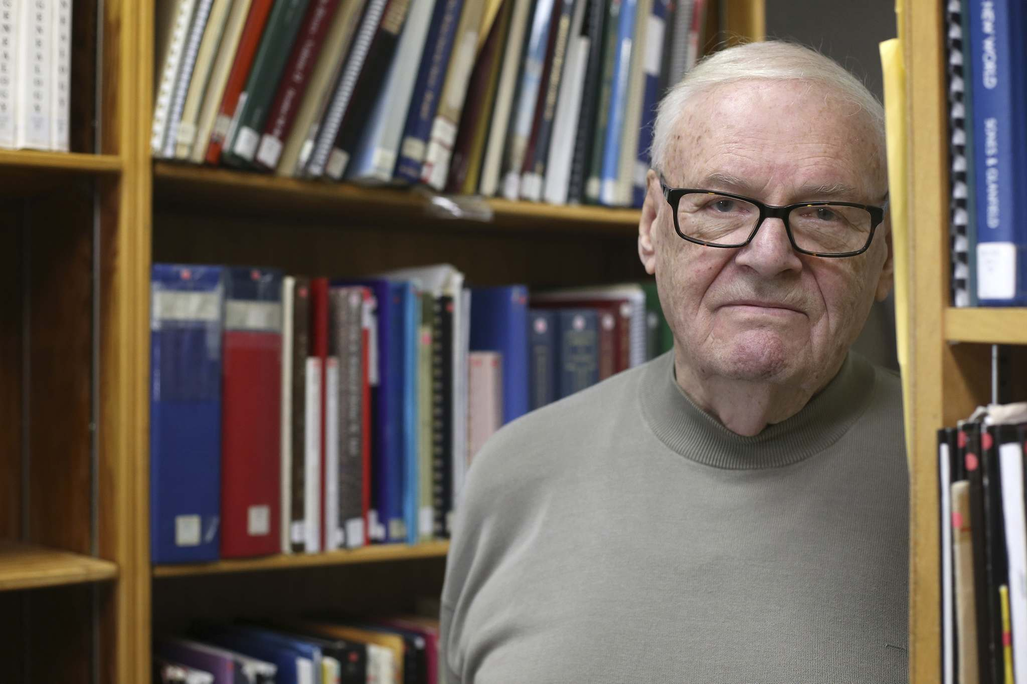 Jim Rutherford stands among shelves of research material at the Manitoba Genealogical Society library and resource centre on St. James Street. Rutherford is the group's volunteer head of research.</p></p>