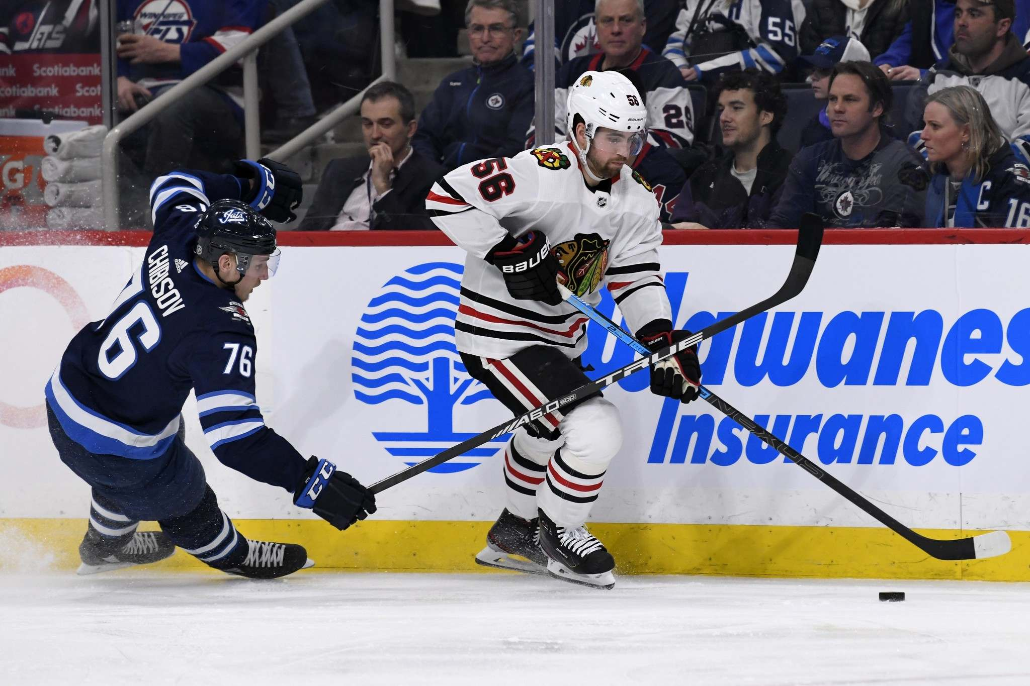 Fred Greenslade</p><p>/ The Canadian Press</p><p>Chicago Blackhawks' Erik Gustafsson (56) skates away from Winnipeg Jets' Andrei Chibisov (76) during second period NHL action in Winnipeg on Sunday, Feb. 16, 2020.</p>