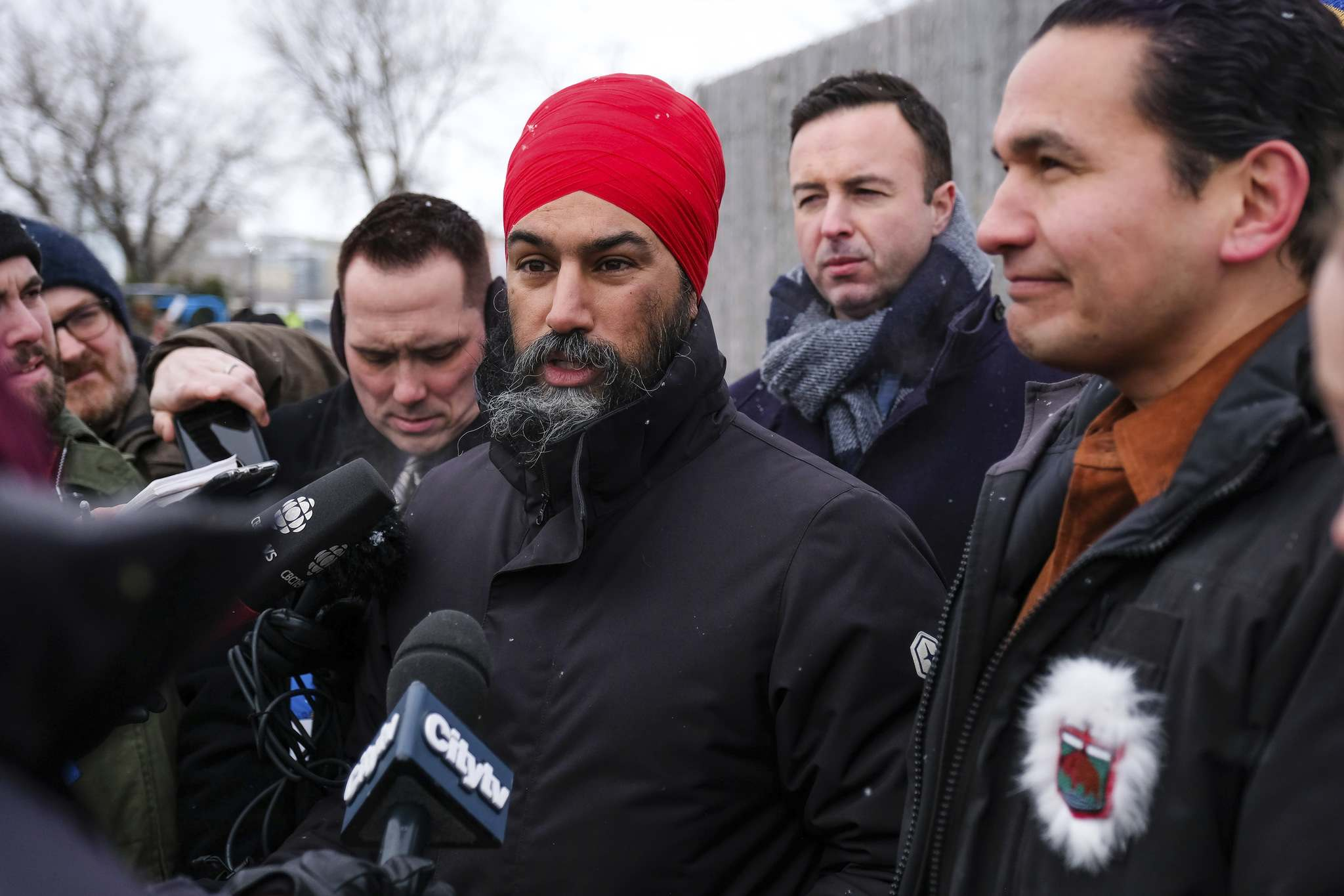 Daniel Crump / Winnipeg Free Press</p><p>Federal NDP Leader Jagmeet Singh (middle) and Provincial NDP Leader Wab Kinew (right) field questions from the media at Festival du Voyageur on Monday.</p>
