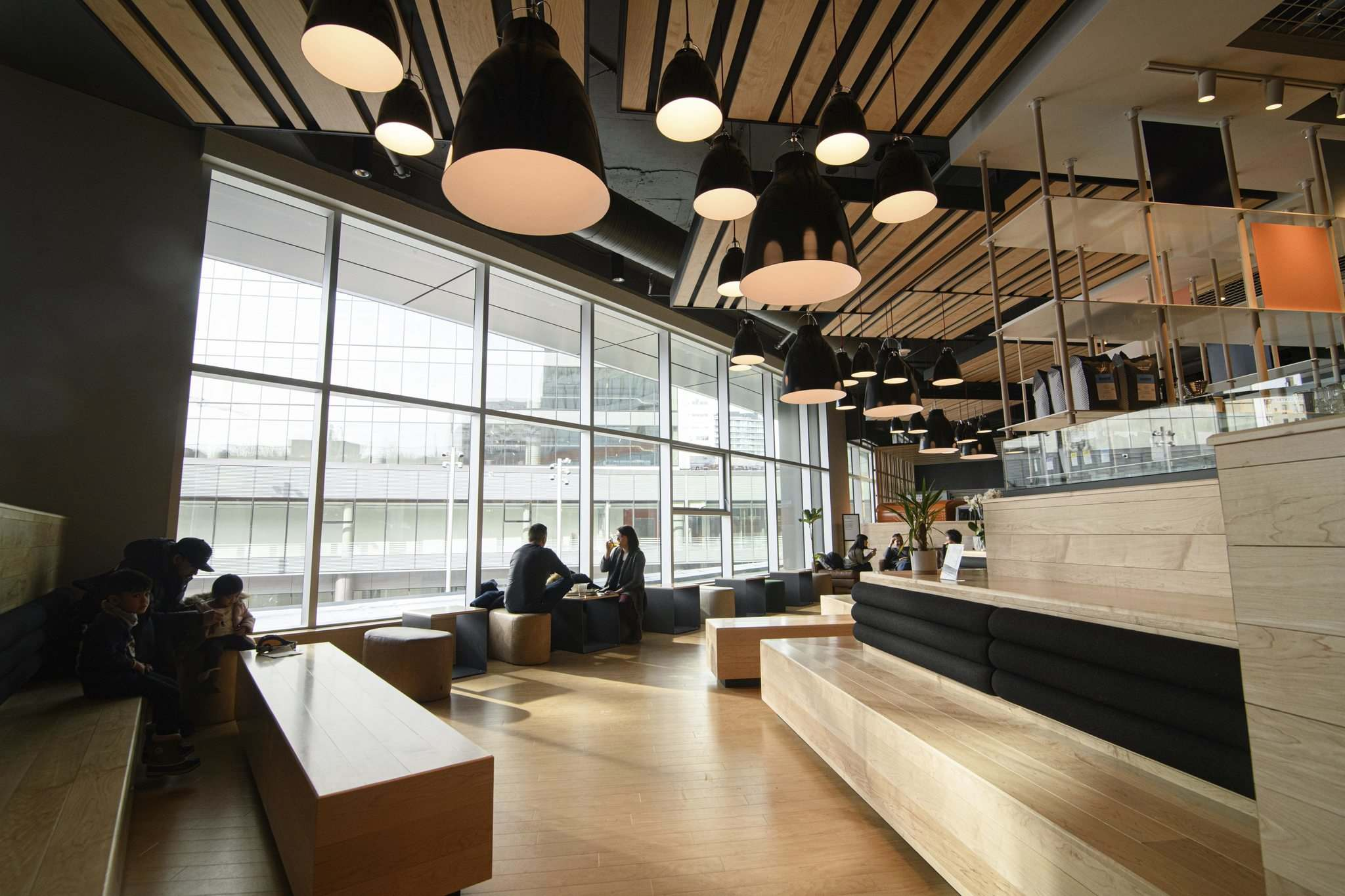The new downtown food court features sleek bench seating and floor-to-ceiling windows. The room gets packed before Jets games. (Mike Sudoma / Winnipeg Free Press)