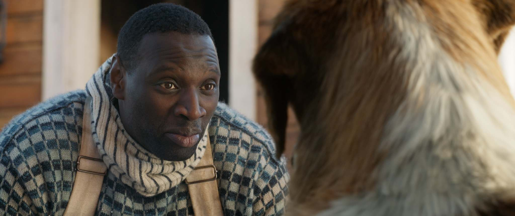 Omar Sy is kindly mail carrier, but Buck isn't with him long. (Twentieth Century Fox)