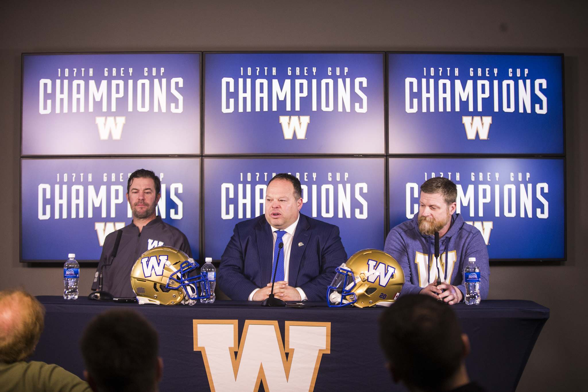 General manager Kyle Walters (from left), president and CEO Wade Miller and head coach Mike O'Shea speak to the media after the team's Grey Cup victory. (Mikaela MacKenzie / Winnipeg Free Press files)