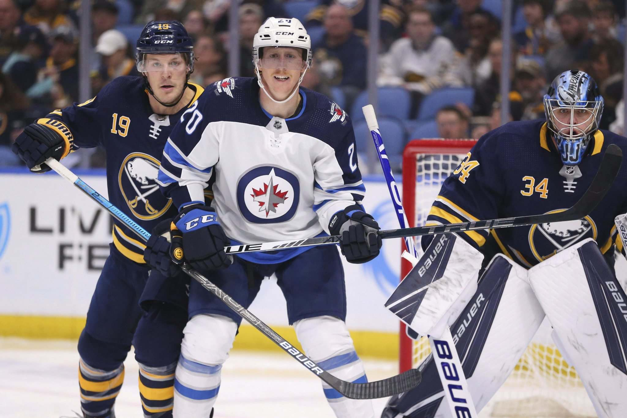 Jeffrey T. Barnes / The Associated Press</p><p>Buffalo Sabres defenseman Jake McCabe (19) and Winnipeg Jets forward Cody Eakin (20) battle for position during the second period of an NHL hockey game Sunday, Feb. 23, 2020, in Buffalo, N.Y.</p>