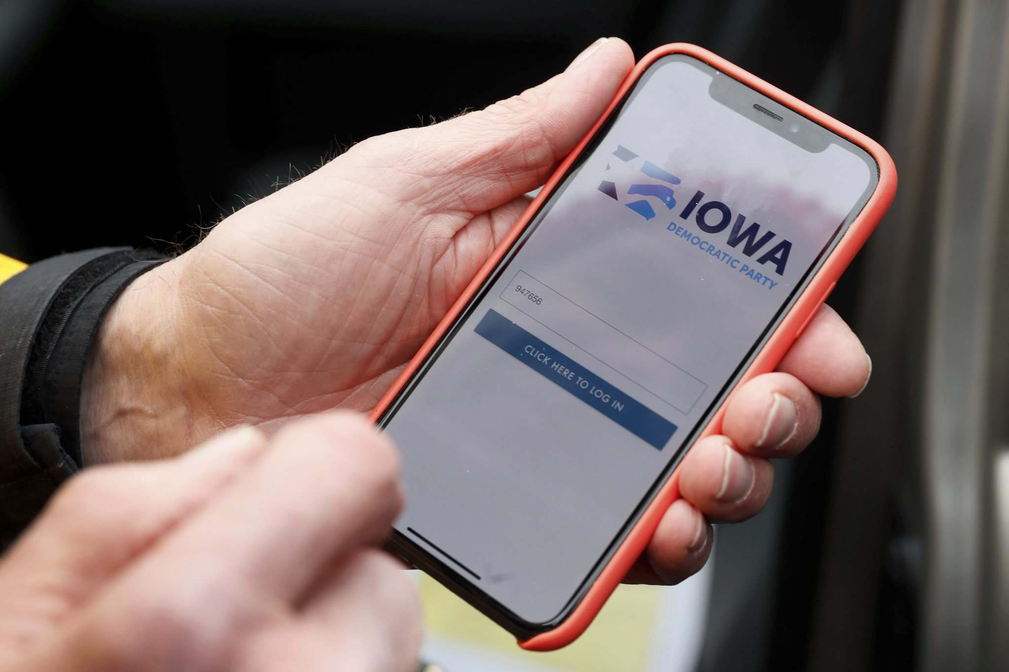 Charlie Neibergall / The Associated Press Files</p><p>A precinct captain in Des Moines, Iowa, holds his iPhone showing the Iowa Democratic Party's troublesome caucus-reporting app.</p>