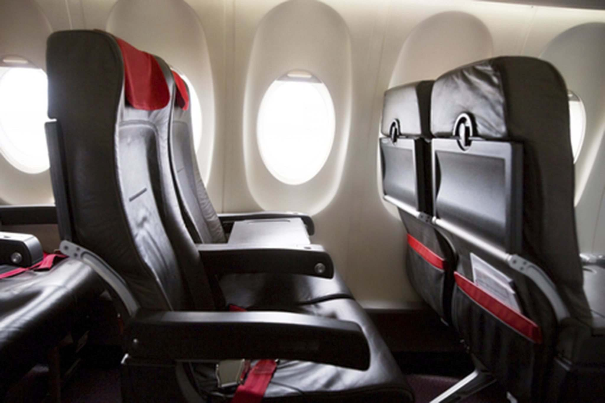 Germs on airplane seats and trays are more likely to be a problem than those in the air. (Dreamstime / TNS files)