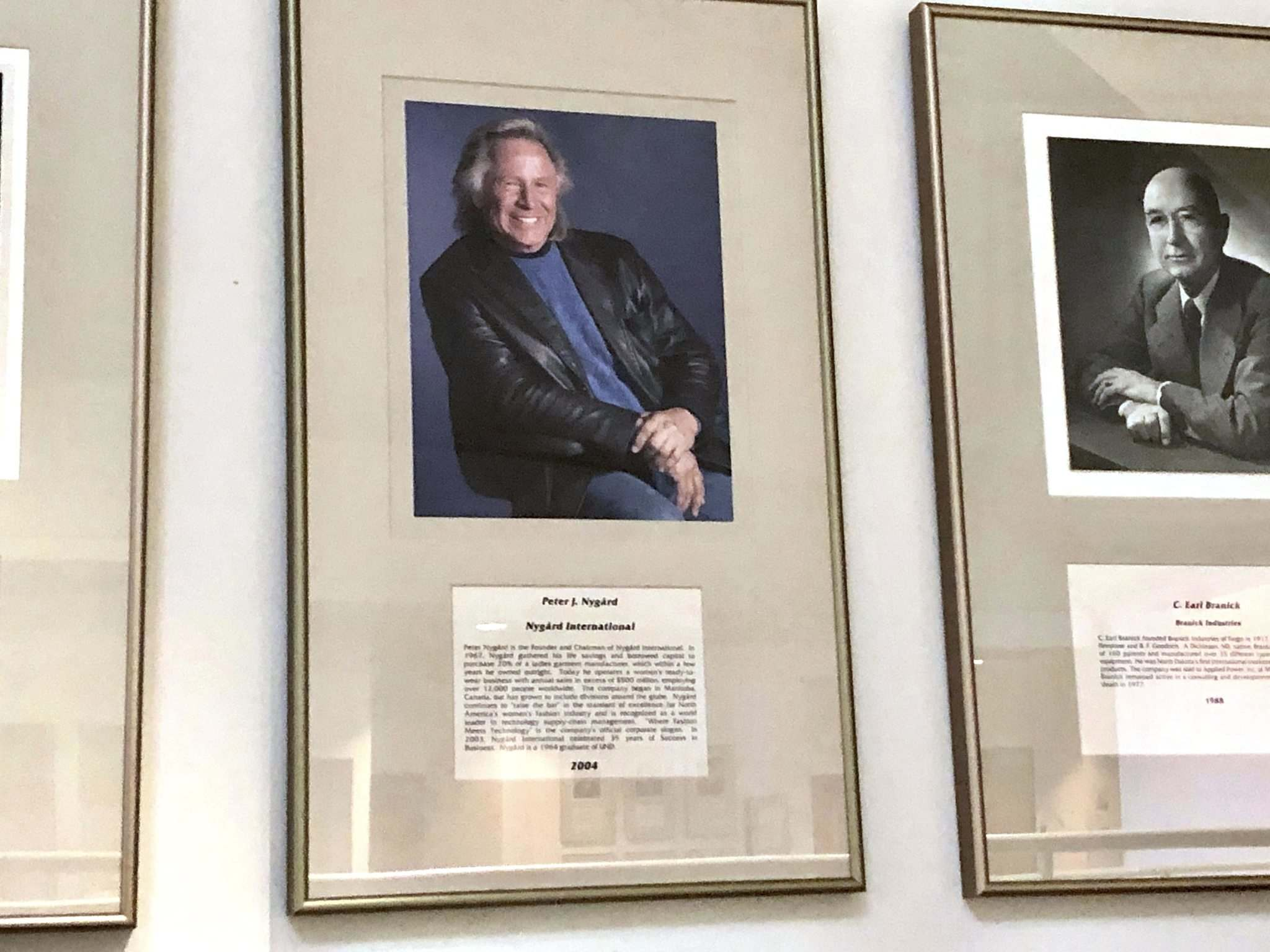 Sydney Mook / Grand Forks Herald</p><p>Peter Nygard's plaque hangs on a wall at the University of North Dakota.</p></p>