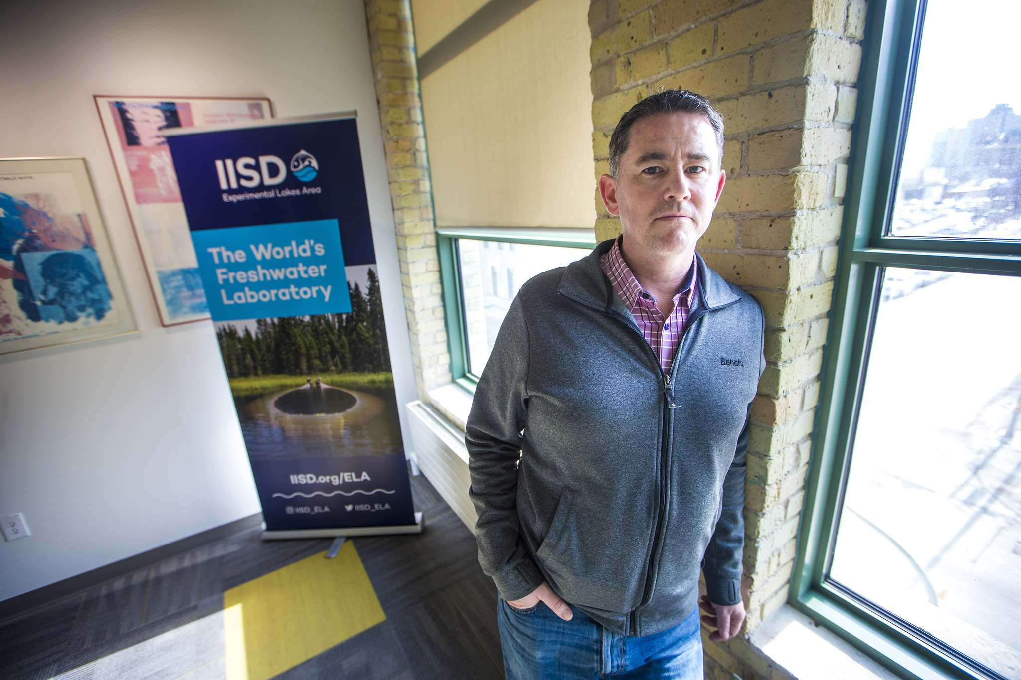 Scott Higgins, research scientist at the IISD Experimental Lakes Area Inc, poses for a portrait in his office in Winnipeg. (Mikaela MacKenzie / Winnipeg Free Press)