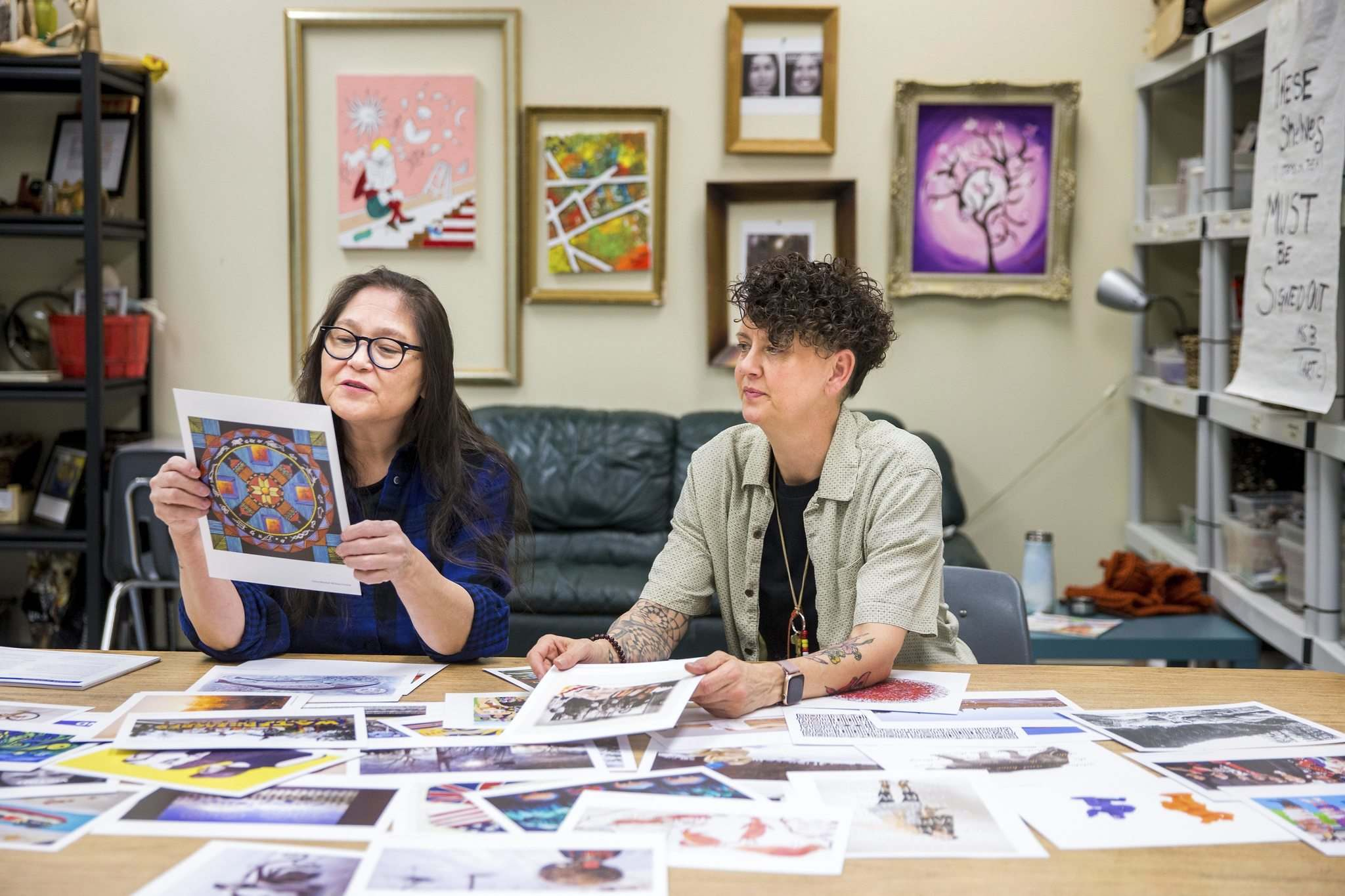Artist Lita Fontaine (left) and art teacher Barb Bottle with the MAWA art cards, which includes a teaching guide informed by the Truth and Reconciliation Commission's calls to action on education. (Mikaela MacKenzie / Winnipeg Free Press)