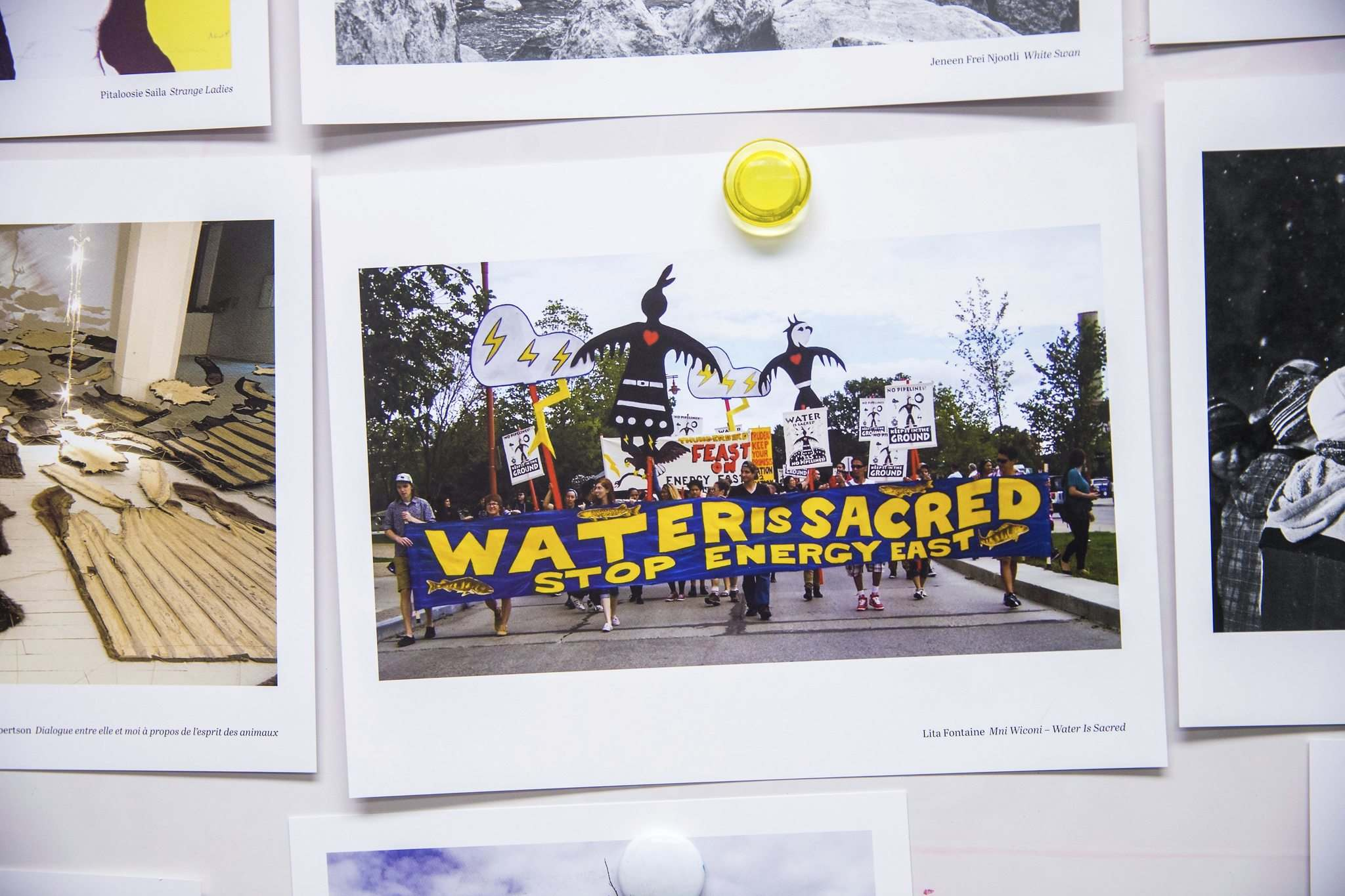 Lita Fontaine's art card is a photograph of pipeline protesters at The Forks. (Mikaela MacKenzie / Winnipeg Free Press)