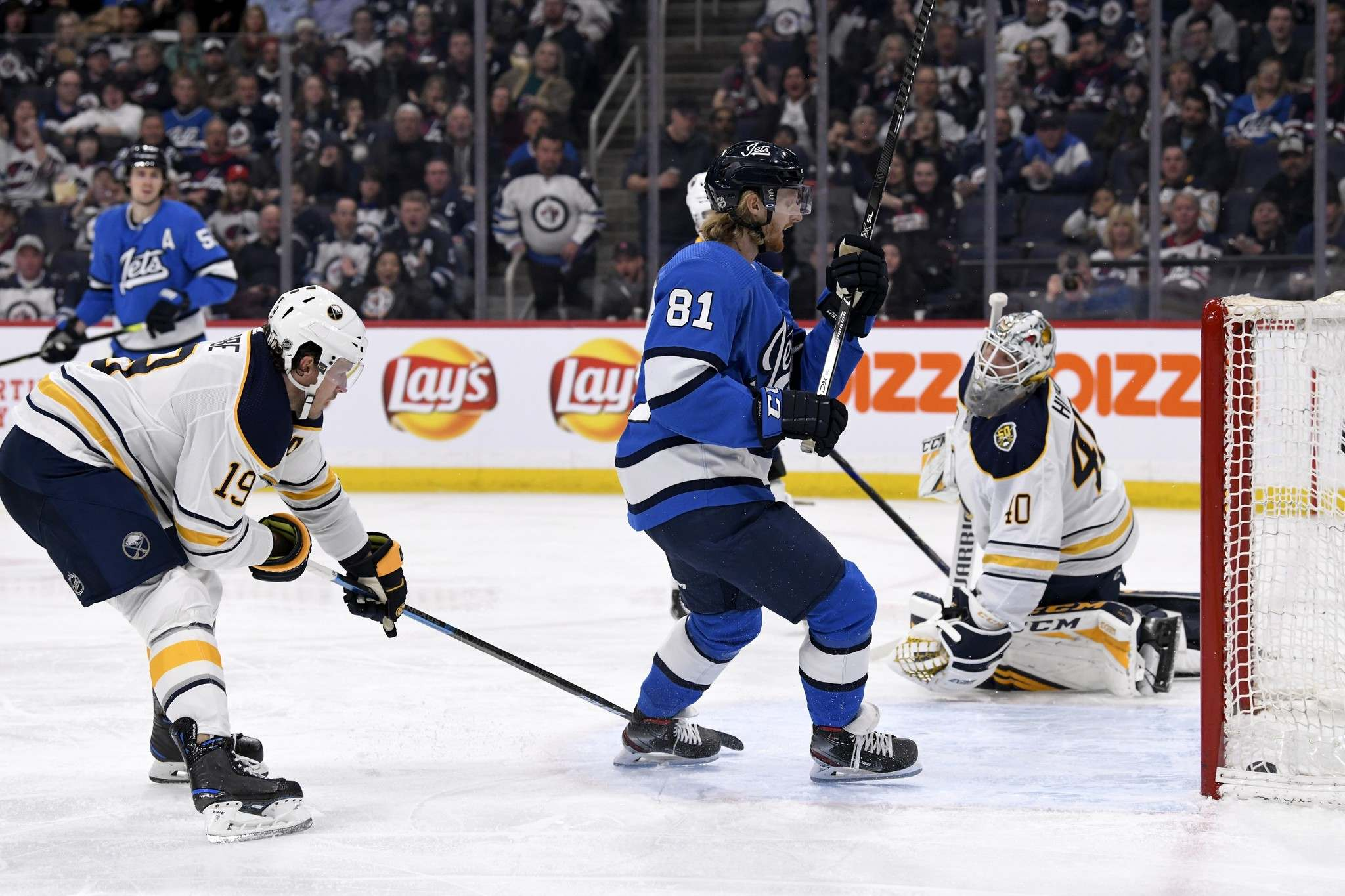 Connor taps in a Mark Scheifele rebound for his second of the night. (Fred Greenslade / The Canadian Press)</p>