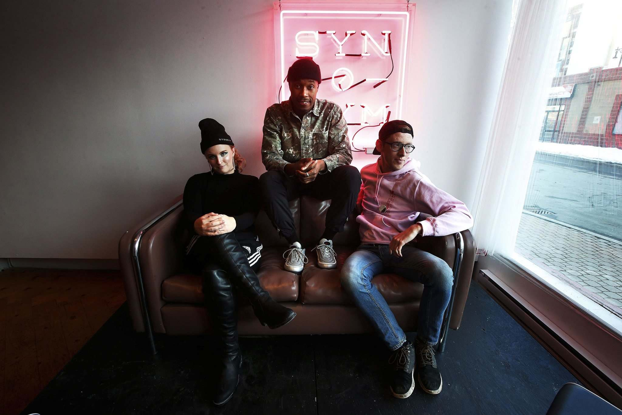 Anthony Sannie, a.k.a. Anthony OKS (centre) worked with Chloe Chafe (left) and Andrew Eastman on the esthetics of his new EP. (John Woods / Winnipeg Free Press)