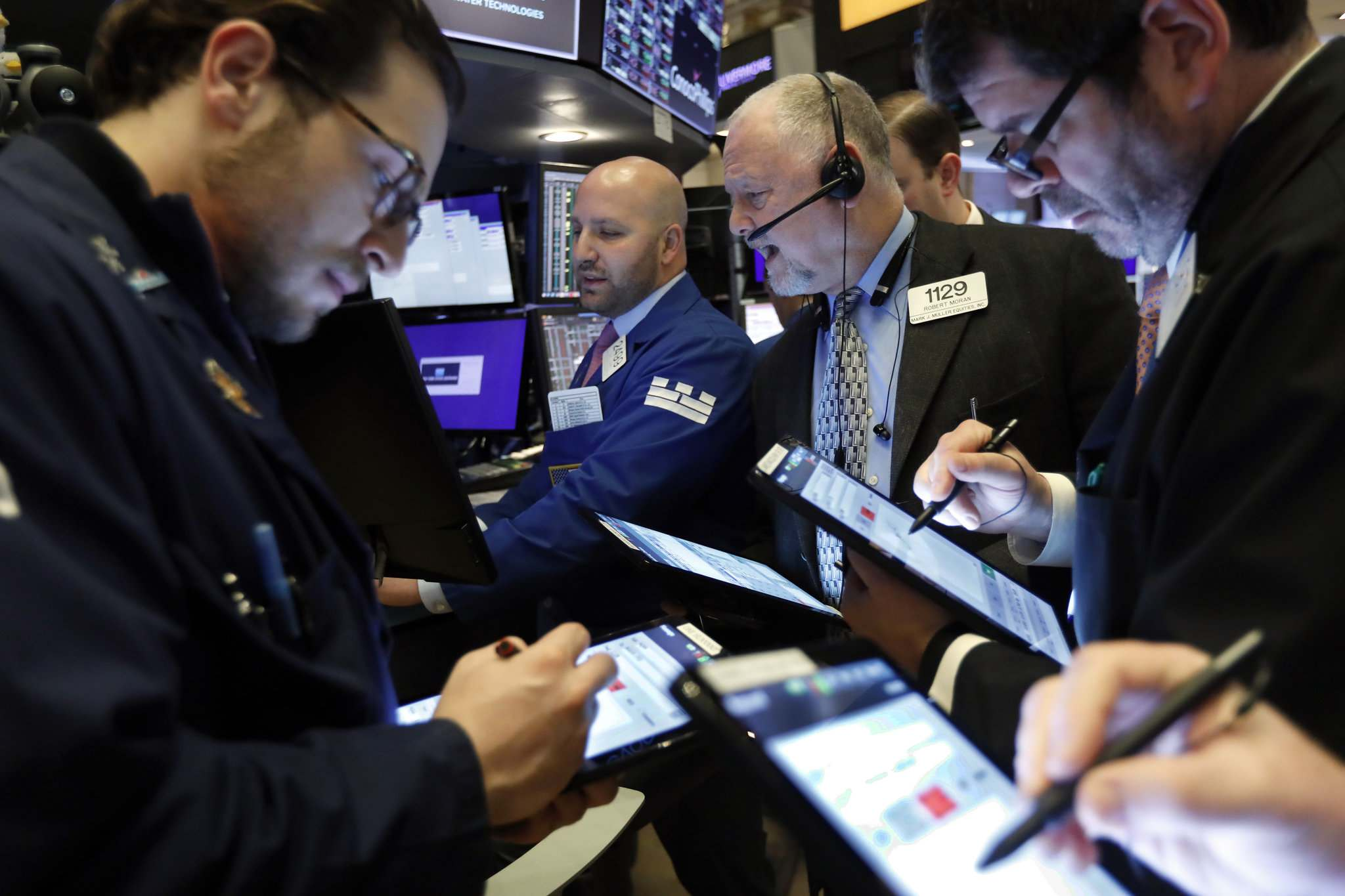 Richard Drew / The Associated Press</p><p>Specialist John Parisi (background centre), works with traders at his post on the floor of the New York Stock Exchange. Stocks opened sharply lower on Wall Street last week and bond yields were sinking to more record lows as investors fear that economic damage from the spreading coronavirus outbreak will be longer than previously thought. </p></p>
