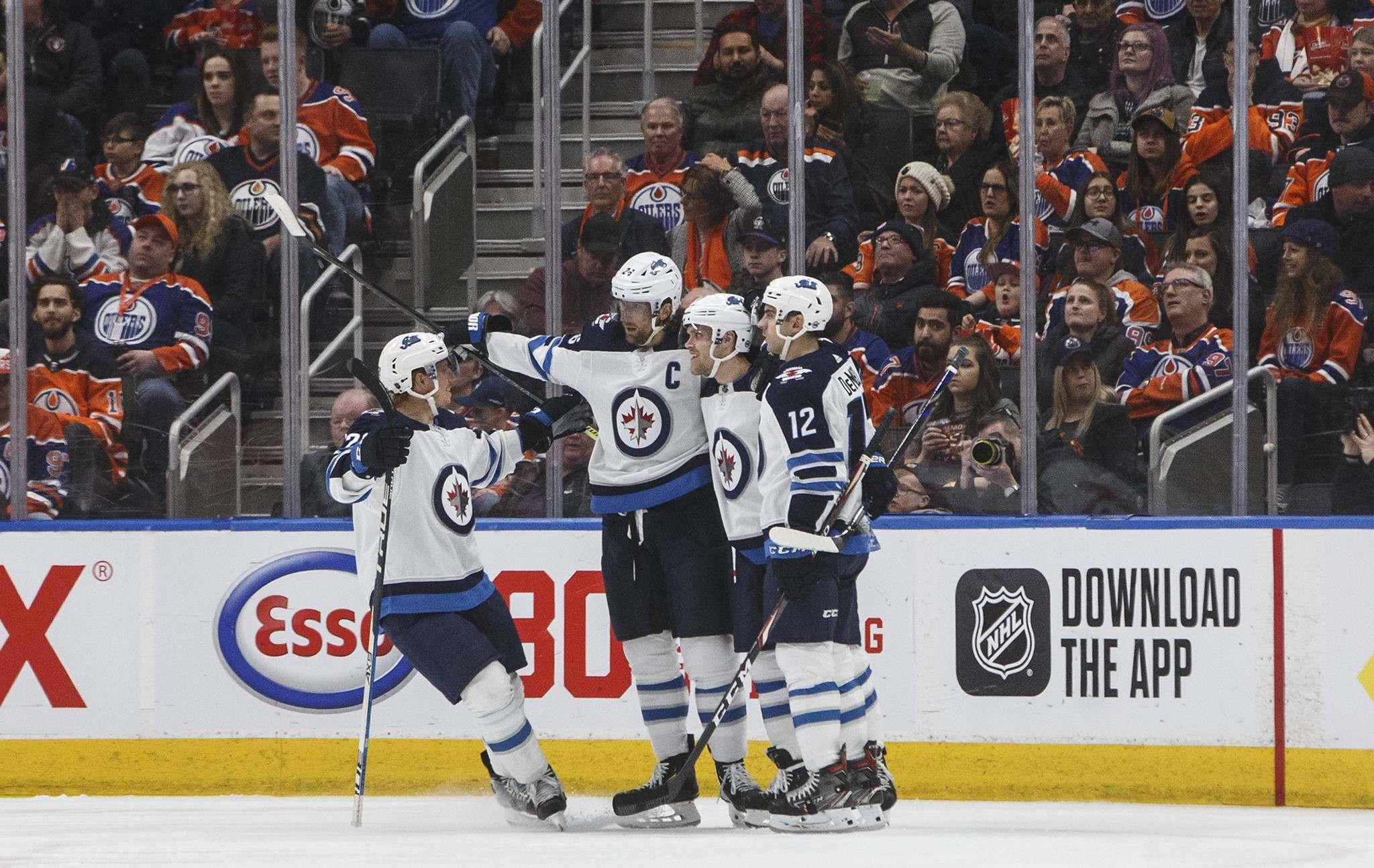 THE CANADIAN PRESS/Jason Franson</p><p>Winnipeg Jets celebrate a goal against the Edmonton Oilers during second period NHL action in Edmonton on Wednesday.</p>