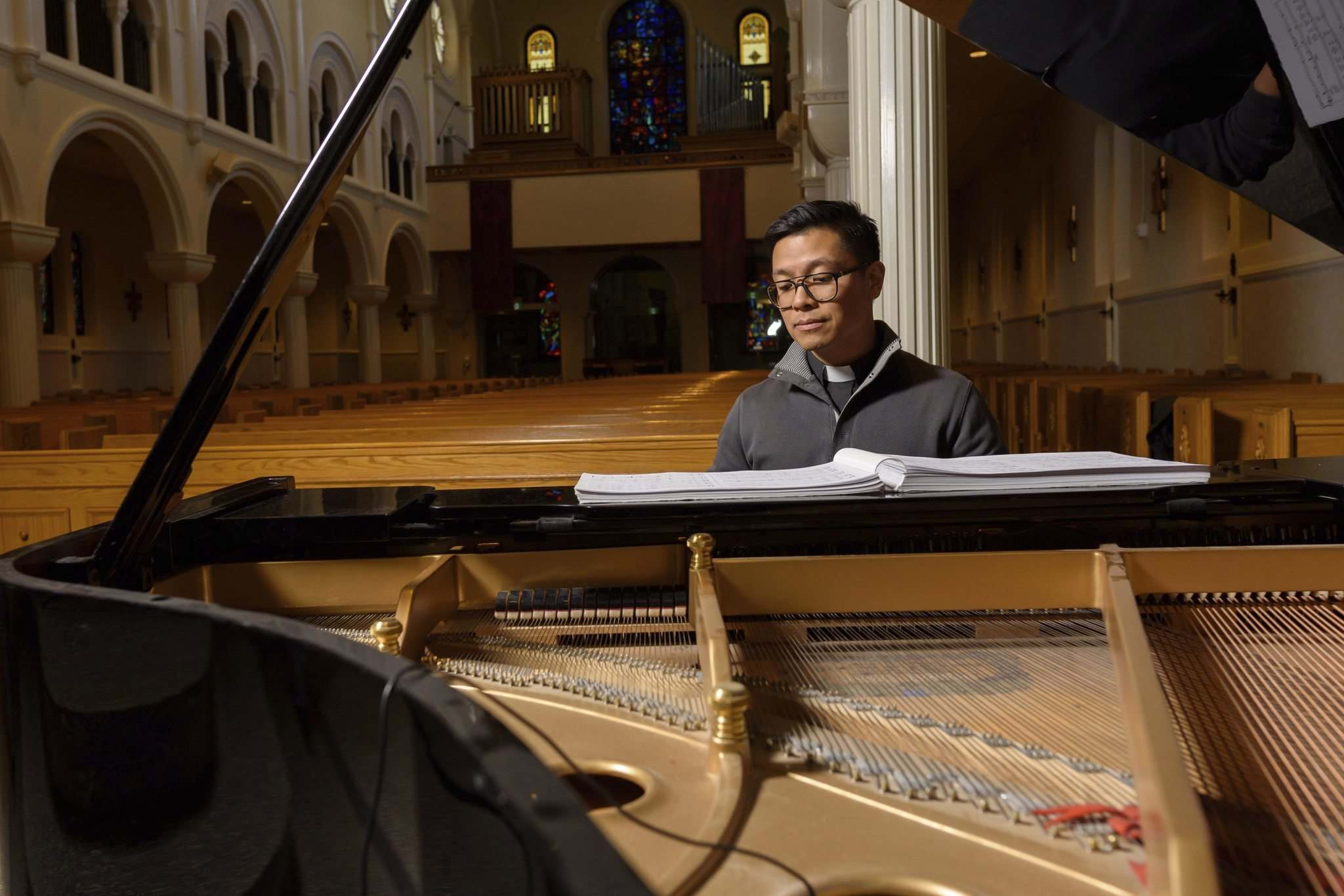 JESSE BOILY / WINNIPEG FREE PRESS</p><p>Rev. Geoffrey Angeles sits at the piano to an empty church on Thursday, March 19, 2020.