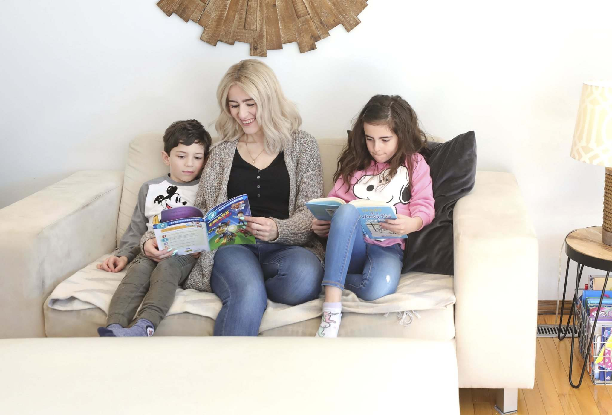 Catherine DiMarco reads at home with her son, Cristiano, and daughter, Gia, on Monday. (Ruth Bonneville / Winnipeg Free Press)