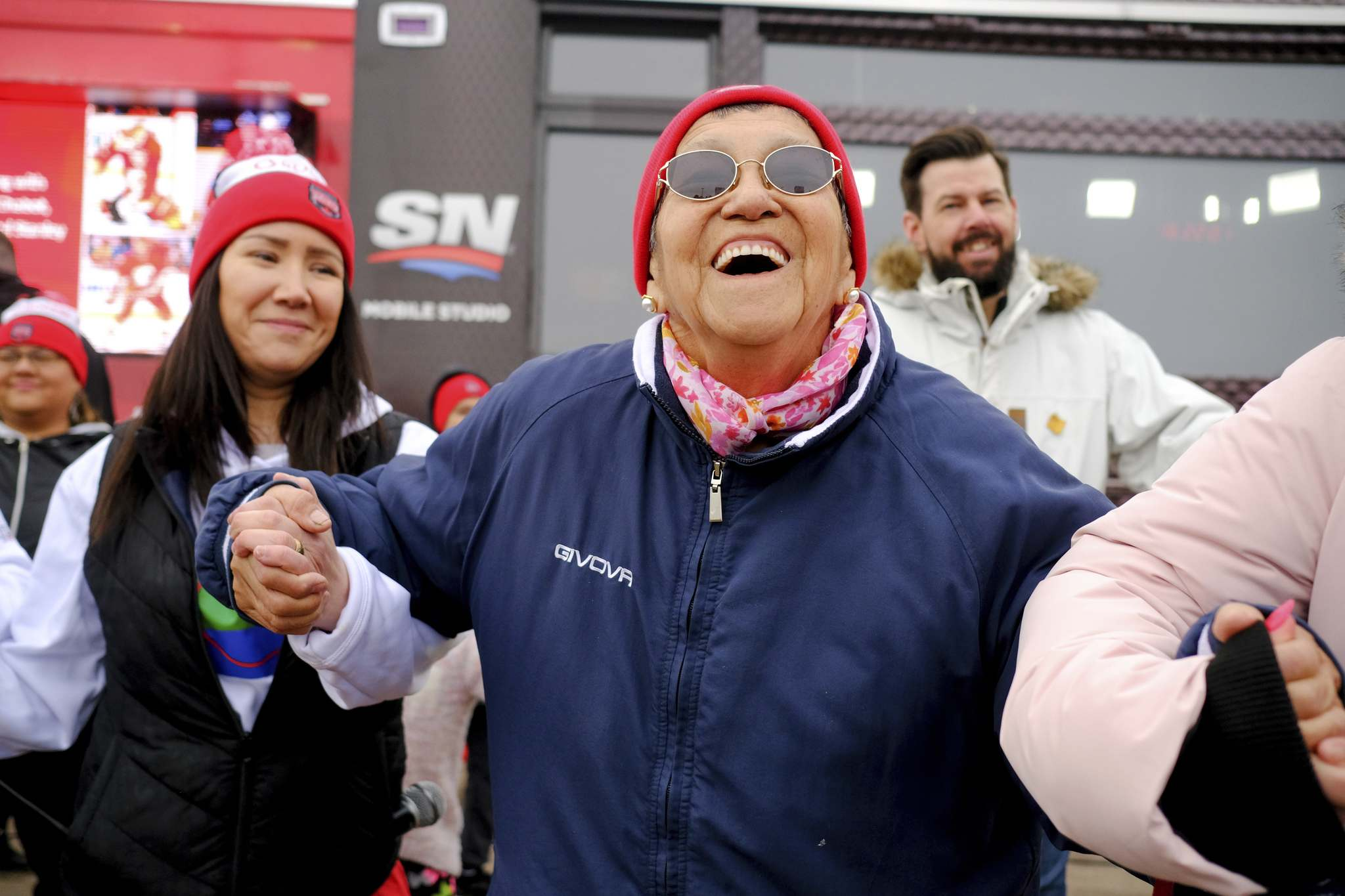 Mike Sudoma / Winnipeg Free Press</p><p>Marge Sinclair and other Peguis residents embrace their Hometown Hockey moment.</p></p>