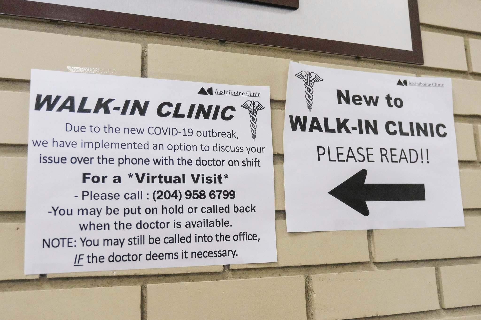DANIEL CRUMP / WINNIPEG FREE PRESS</p><p>Signs at Assiniboince Clinic instruct people how to make a virtual appointment.</p></p>