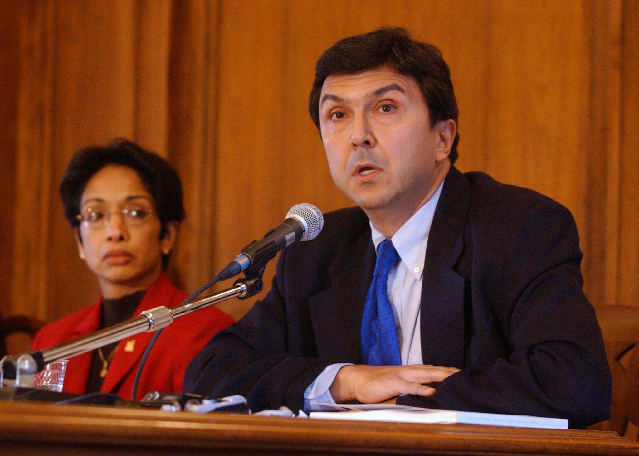 Dr. David Naylor addresses a news conference in Toronto in October 2003.
