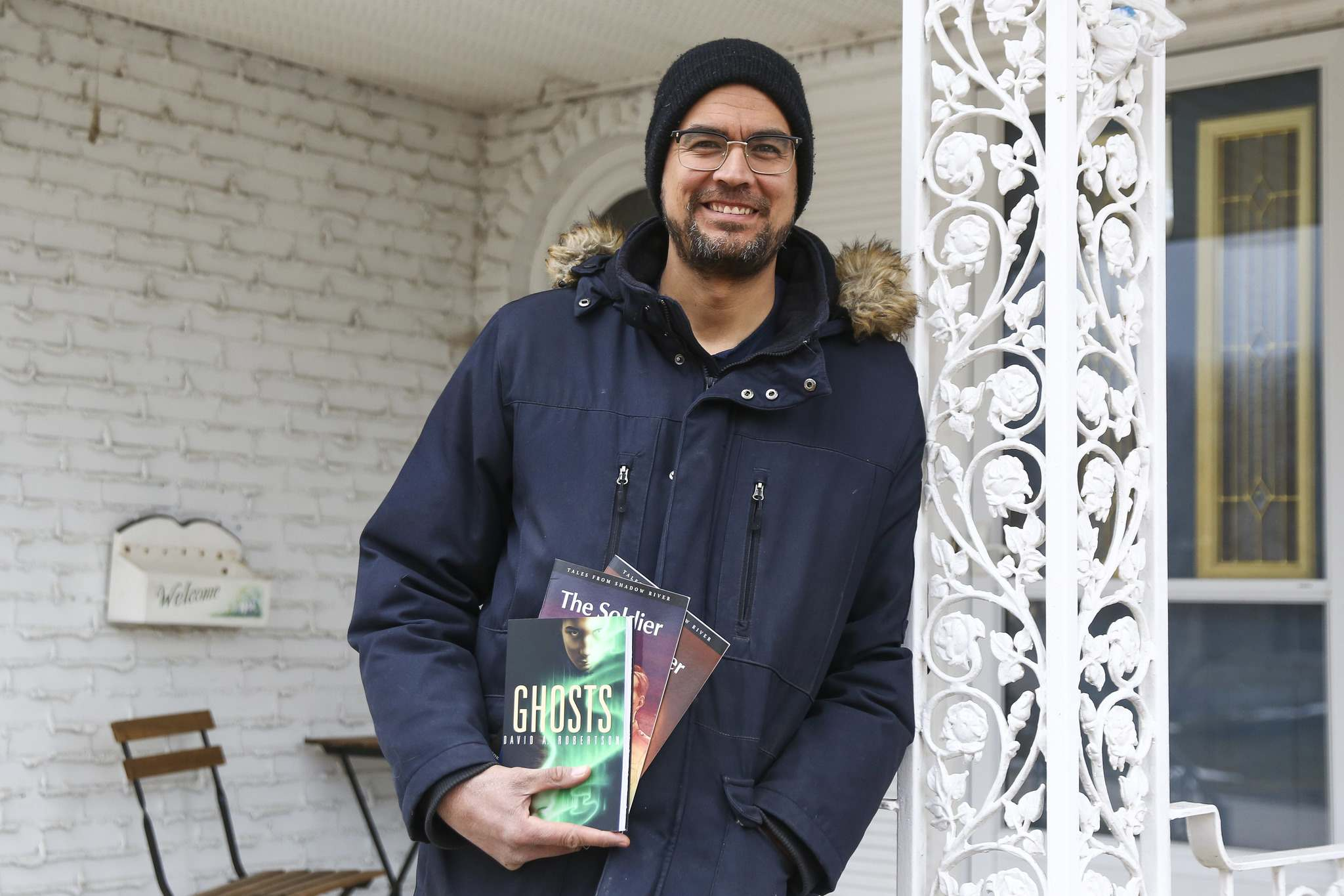 Author David A. Robertson on his front porch in Charleswood.