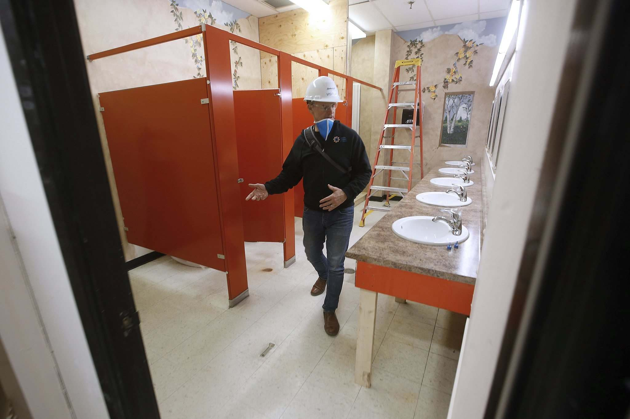 Lees looks through the work that is being done in a borrowed building to help expand their shelter facilities.