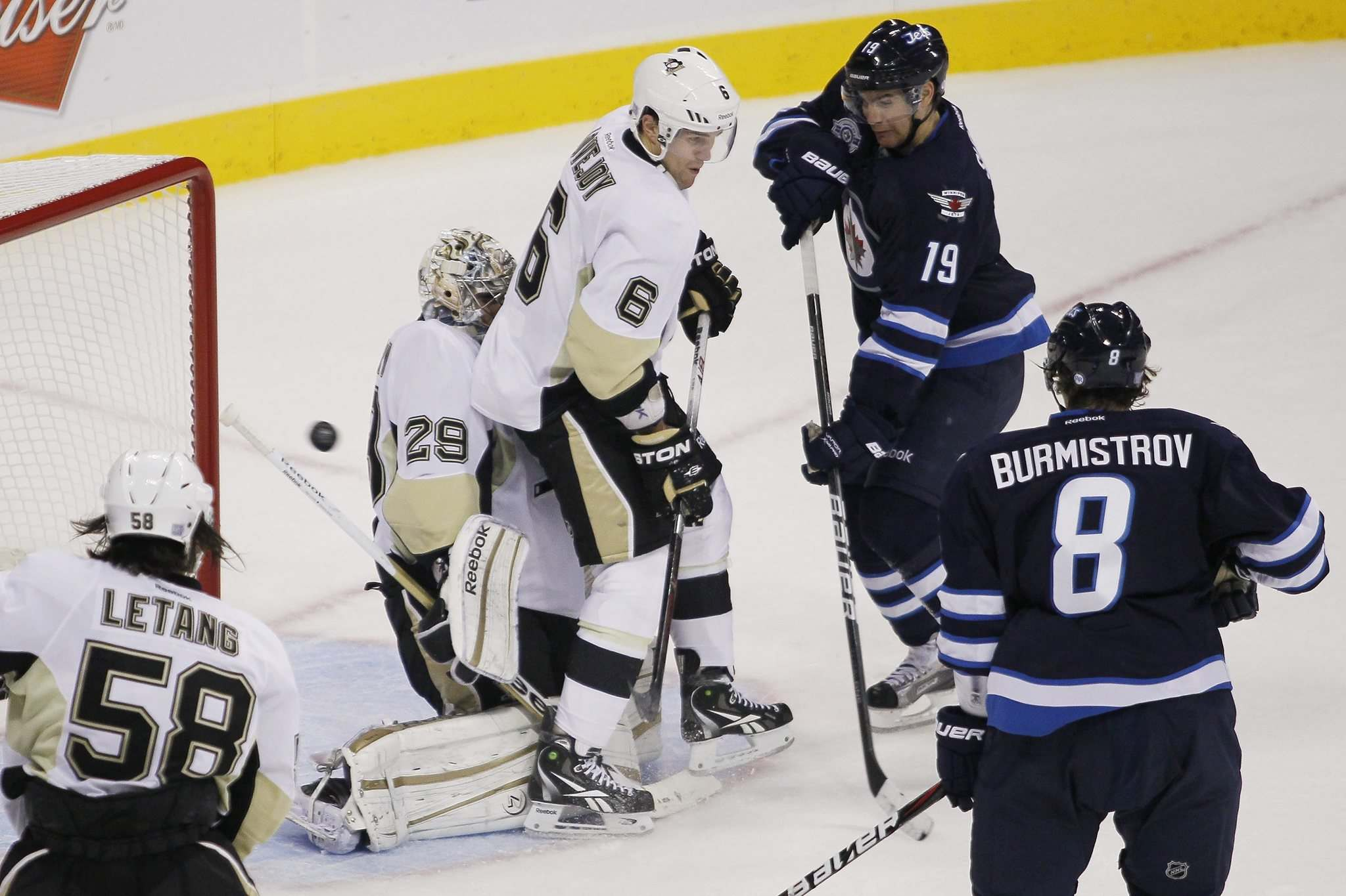 A shot by Winnipeg Jets forward Tanner Glass, not pictured, gets past Pittsburgh Penguins goalie Marc-Andre Fleury and Ben Lovejoy in 2017.
