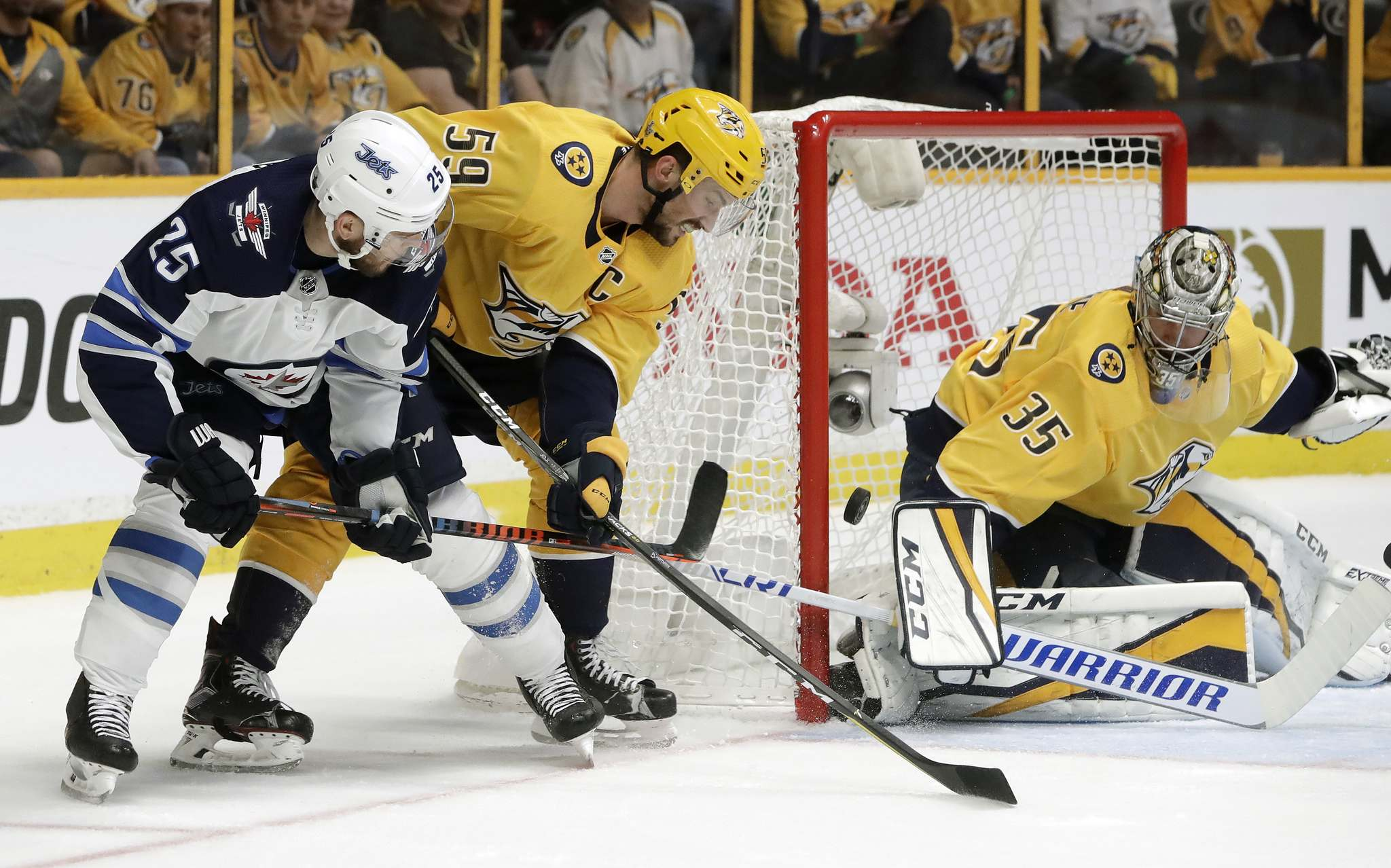 Winnipeg Jets centre Paul Stastny scores a goal between Nashville Predators Roman Josi and Pekka Rinne during the first period of Game 7 of their second-round playoff series in 2018.