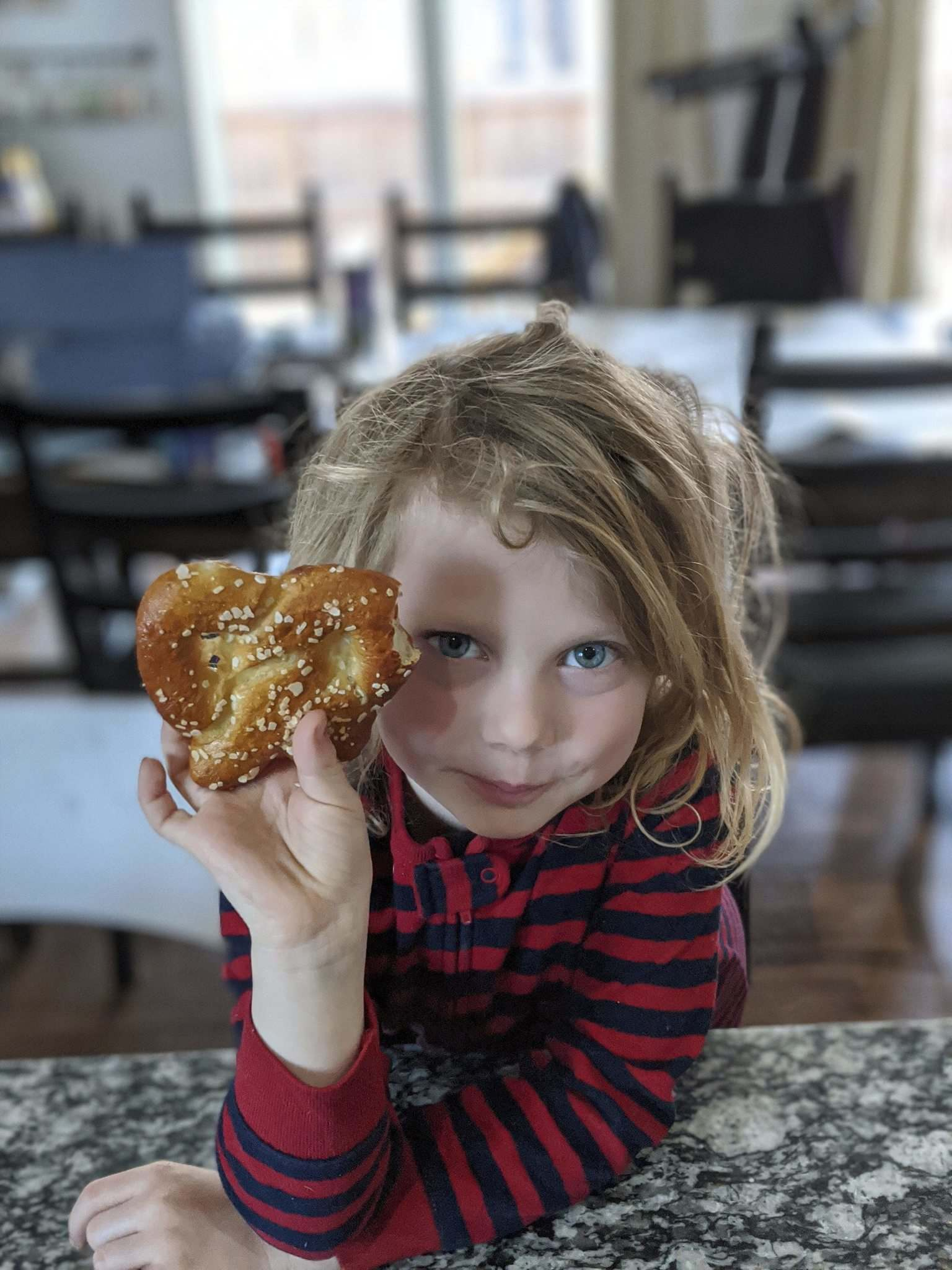 Clara Plesiuk shows off a sourdough pretzel made by her dad, Chris, who has had time to master the artform during the pandemic.</p>