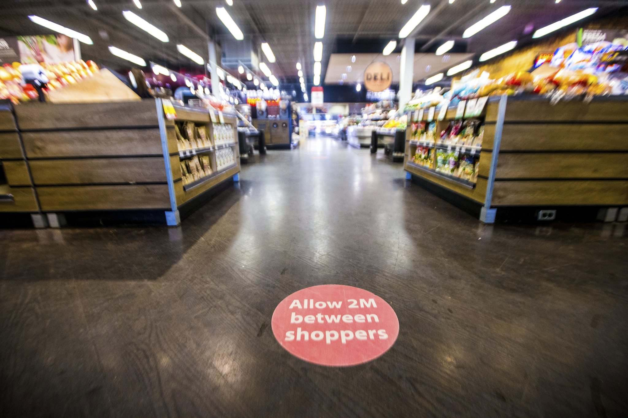 Floor decals encourage social distancing at the Save-On Foods.