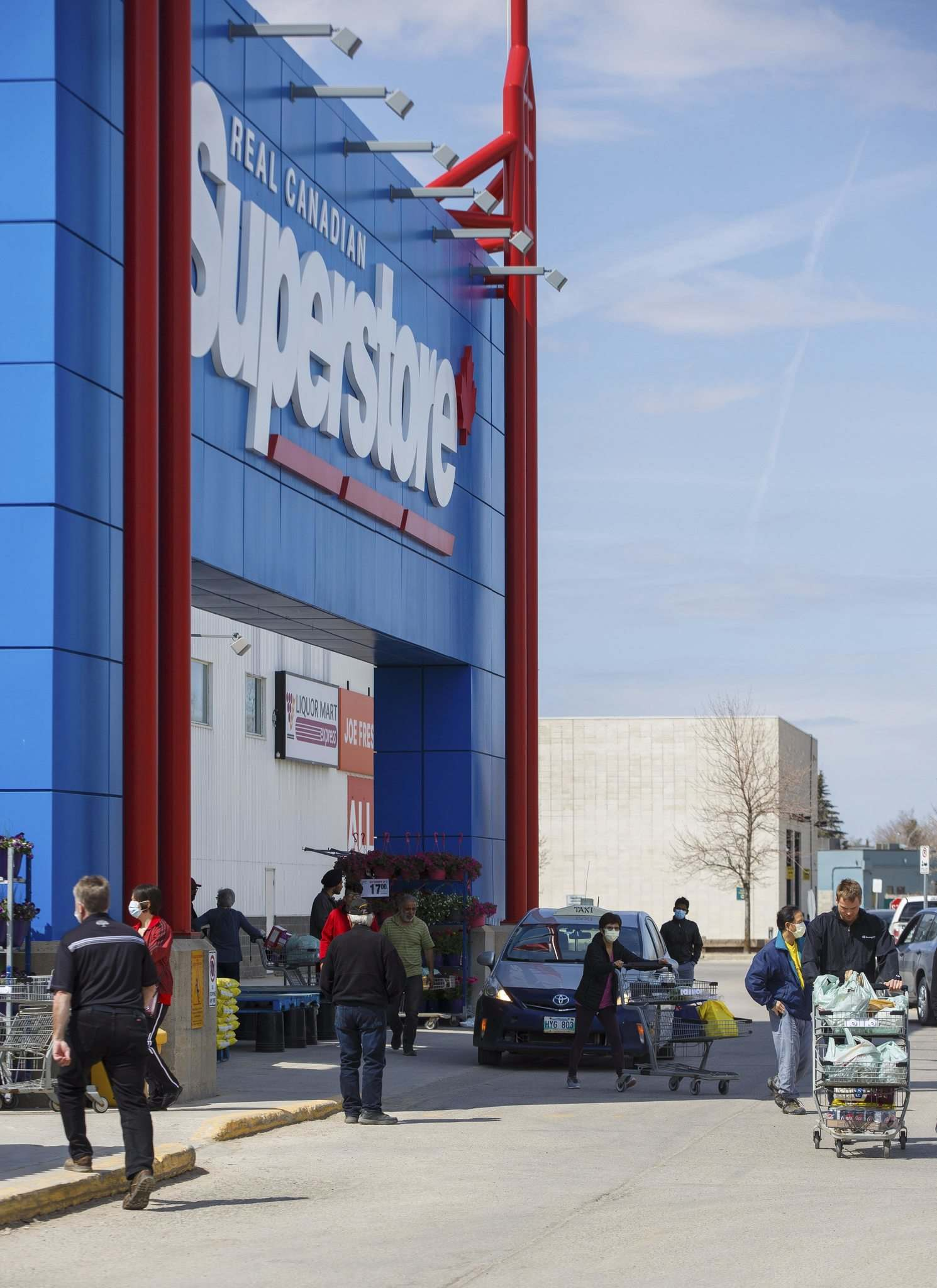 Shoppers outside The Real Canadian Superstore on Bison Drive.