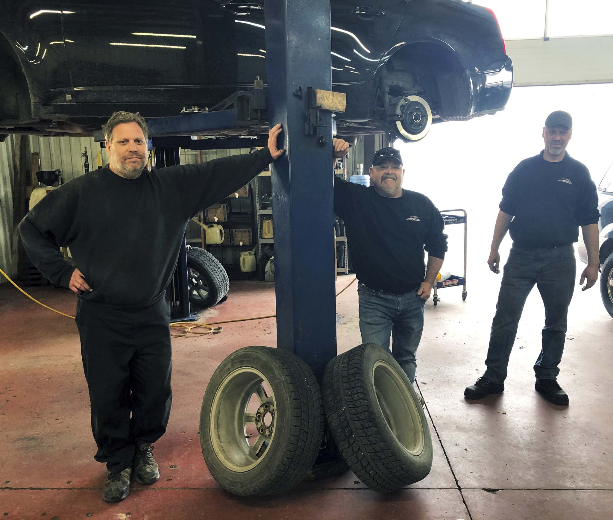 Willy Williamson / Winnipeg Free Press</p><p>Ryan Cook (from left), Dave Geres and Rod Klassen at Auto Check Service Centre. Some elements of the business, such as auto sales and safety inspections, have tapered off, but they're still doing enough repairs to keep the doors open. </p>