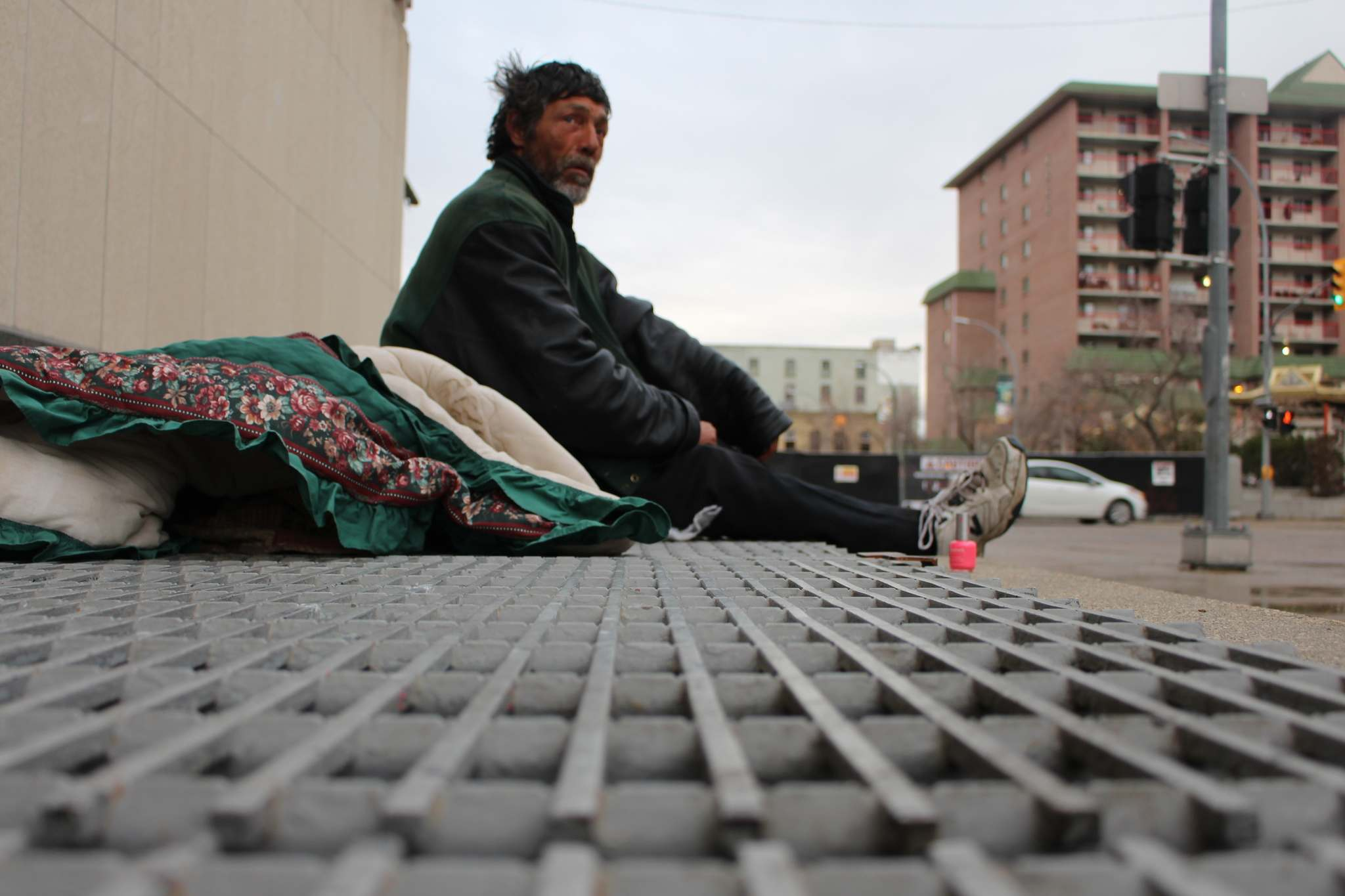 Ron, 55, is homeless and sleeps every night on these grates right outside City Hall.