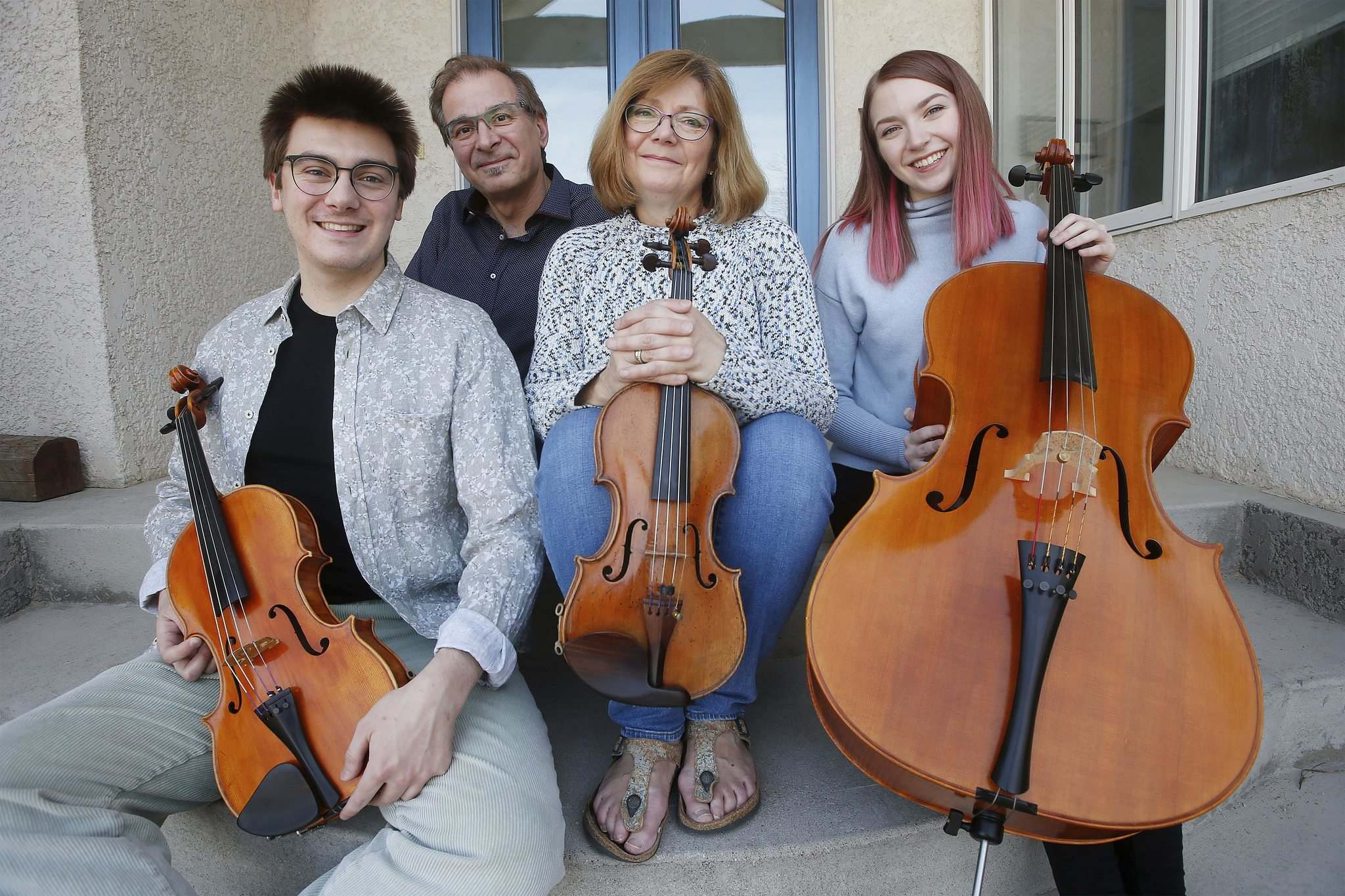 Gwen Hoebig, concertmaster of the WSO, and David Moroz, piano professor at the U of M, with their children Juliana (right) and Sasha.
