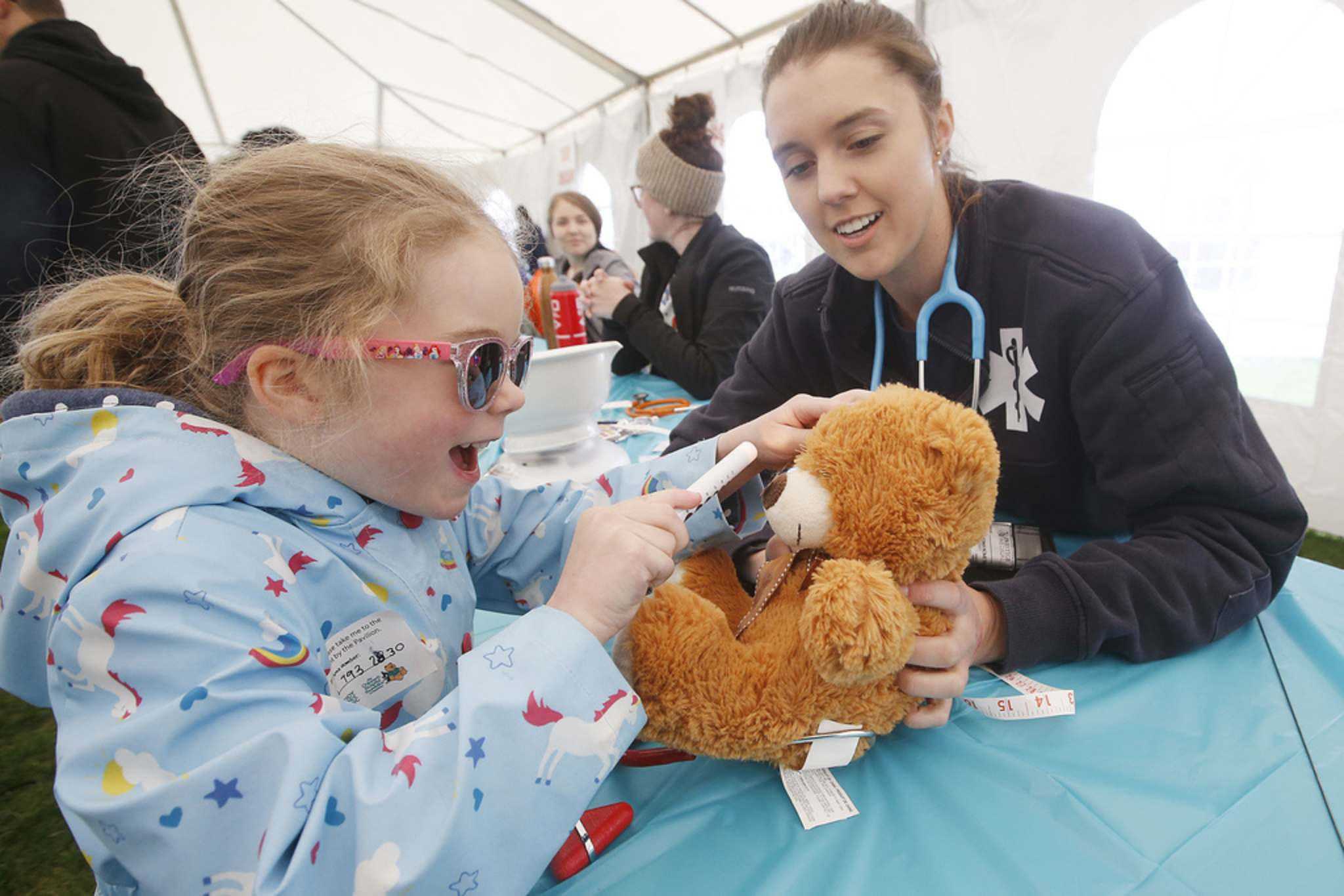 JOHN WOODS / WINNIPEG FREE PRESS FILES</p><p>Millie Hannah inspects her bear's eyes at the Teddy Bear Picnic in Assiniboine Park last May. The annual event held by the Children's Hospital Foundation of Manitoba will move to the web this year with a new 'Gone Virtual' theme.</p>
